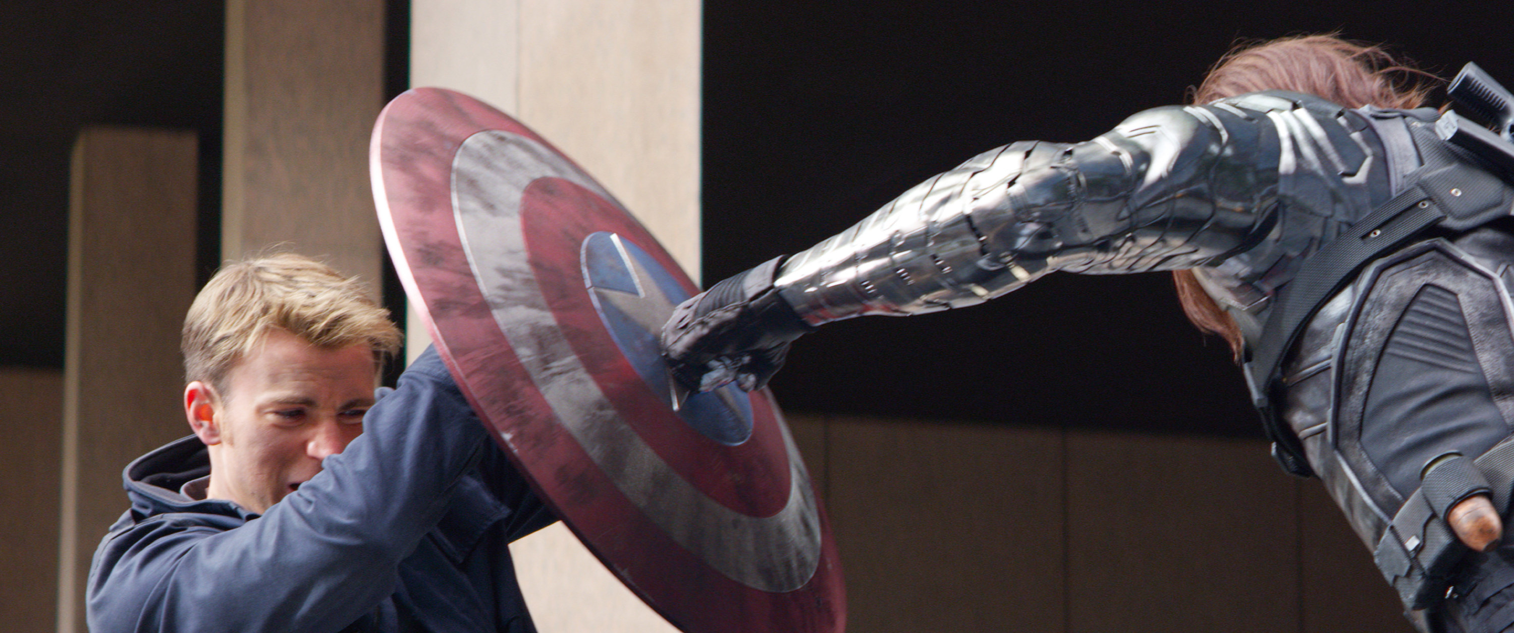 Captain America blocks a punch from The Winter Soldier with his shield.