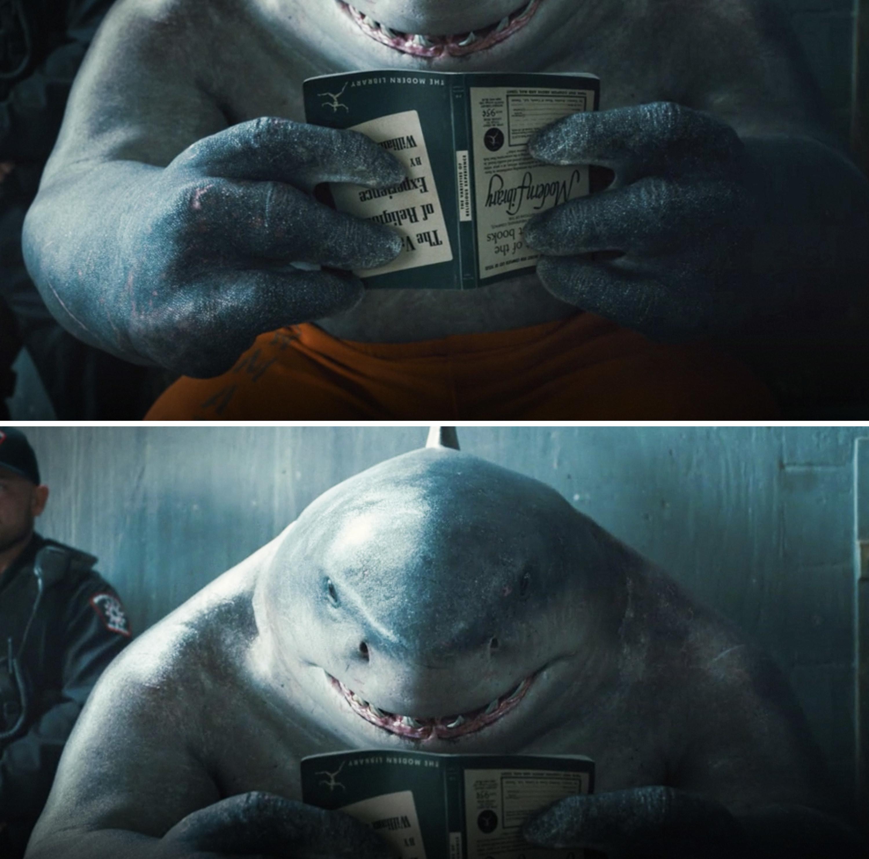 King Shark reading a book upside down