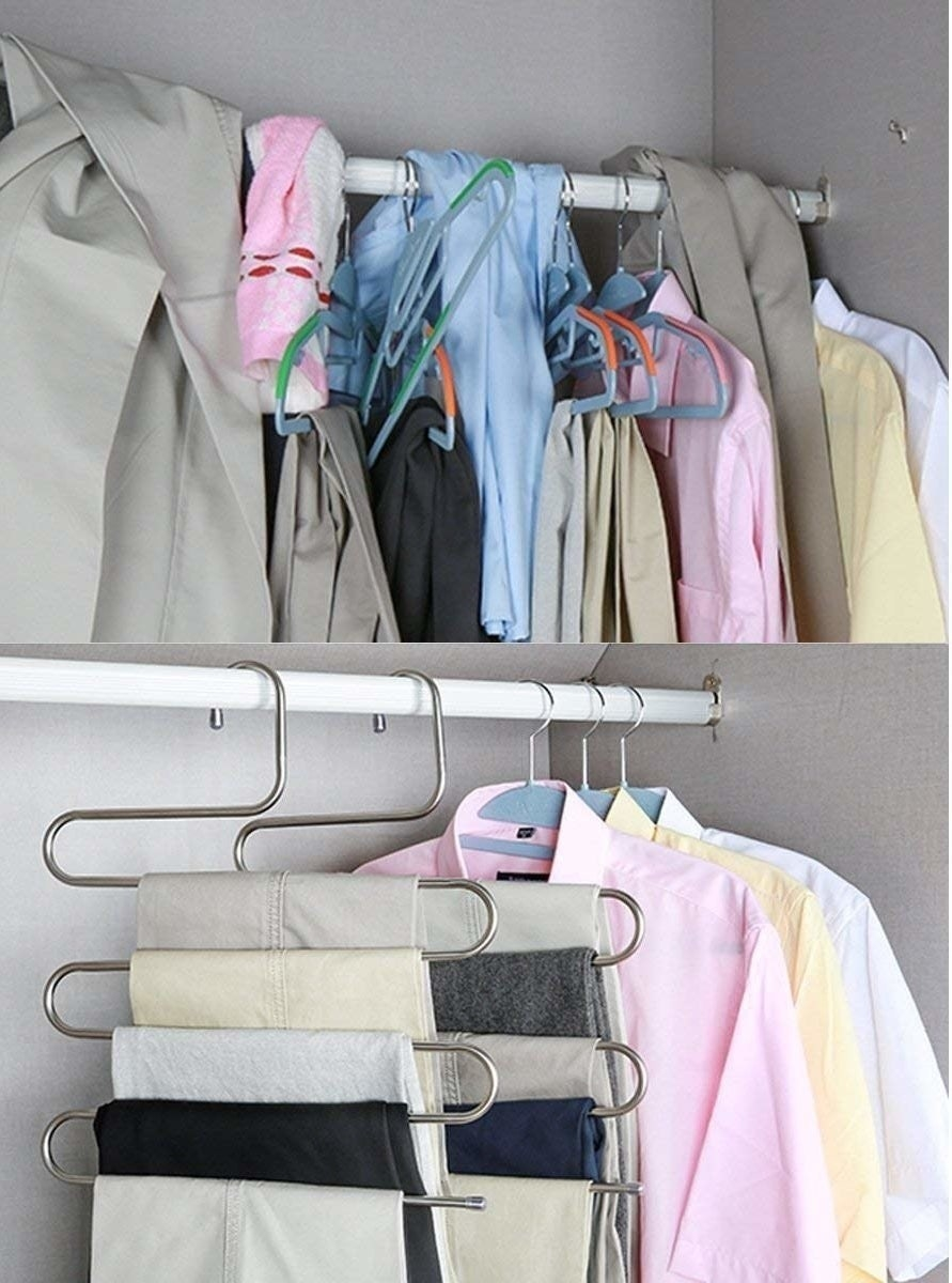 A curved S-shaped hanger holding five pairs of pants on different tiers