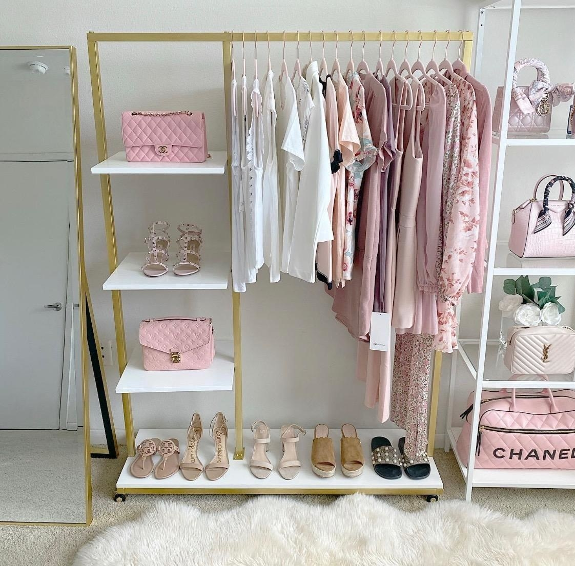 Reviewer photo of the white and gold garment rack