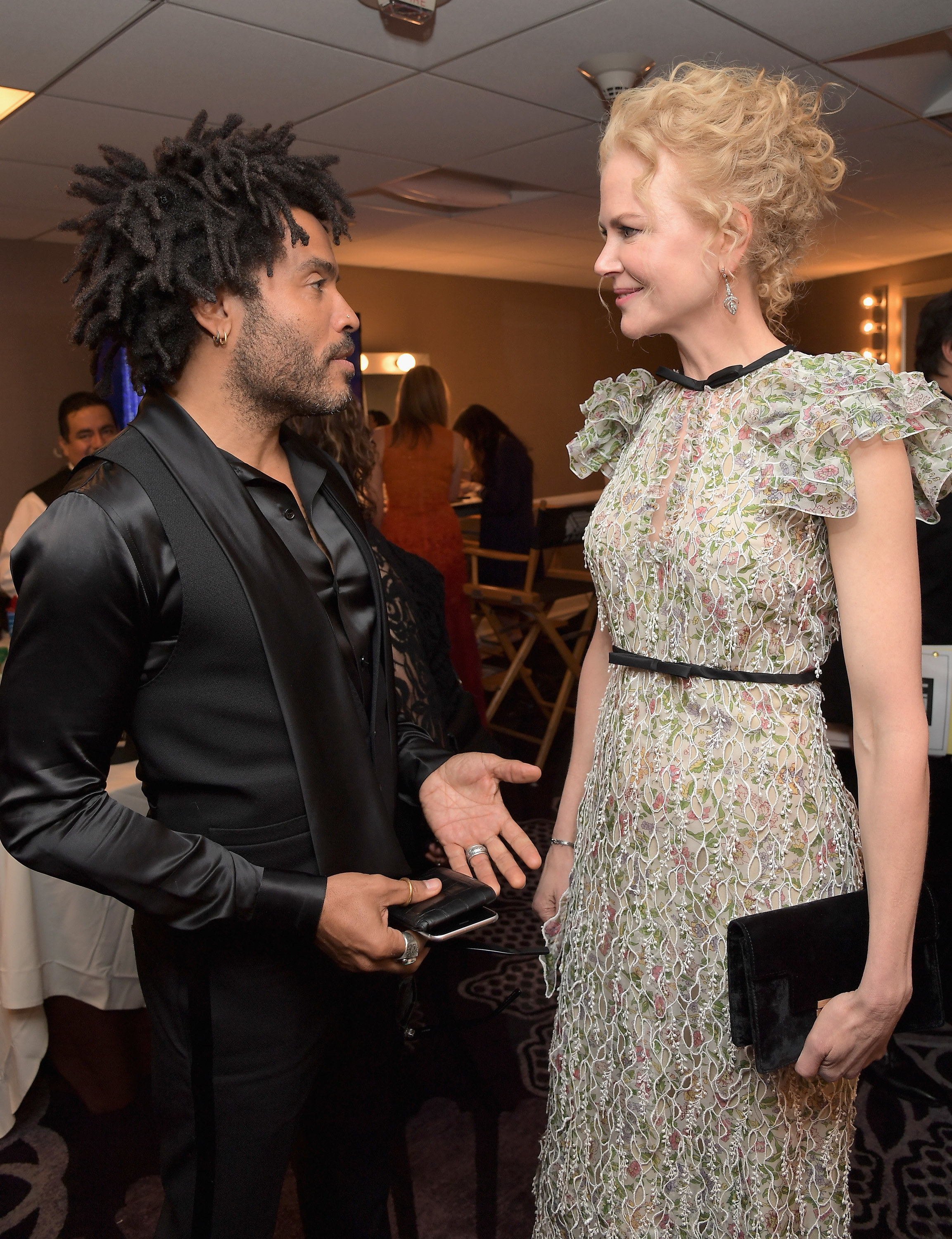 Lenny Kravitz and Nicole Kidman talking backstage at an event
