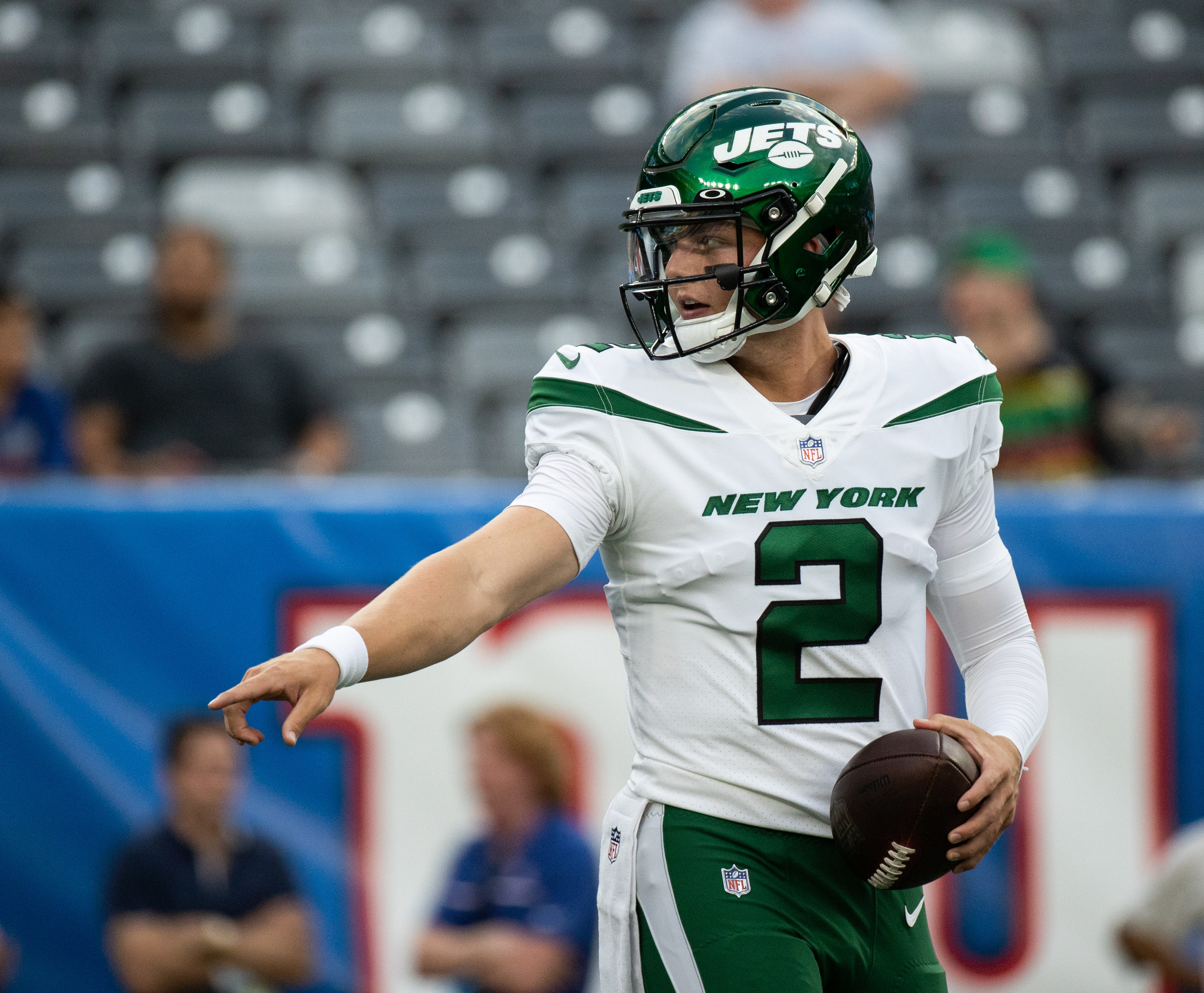 Jets white uniforms with green lettering and helmet