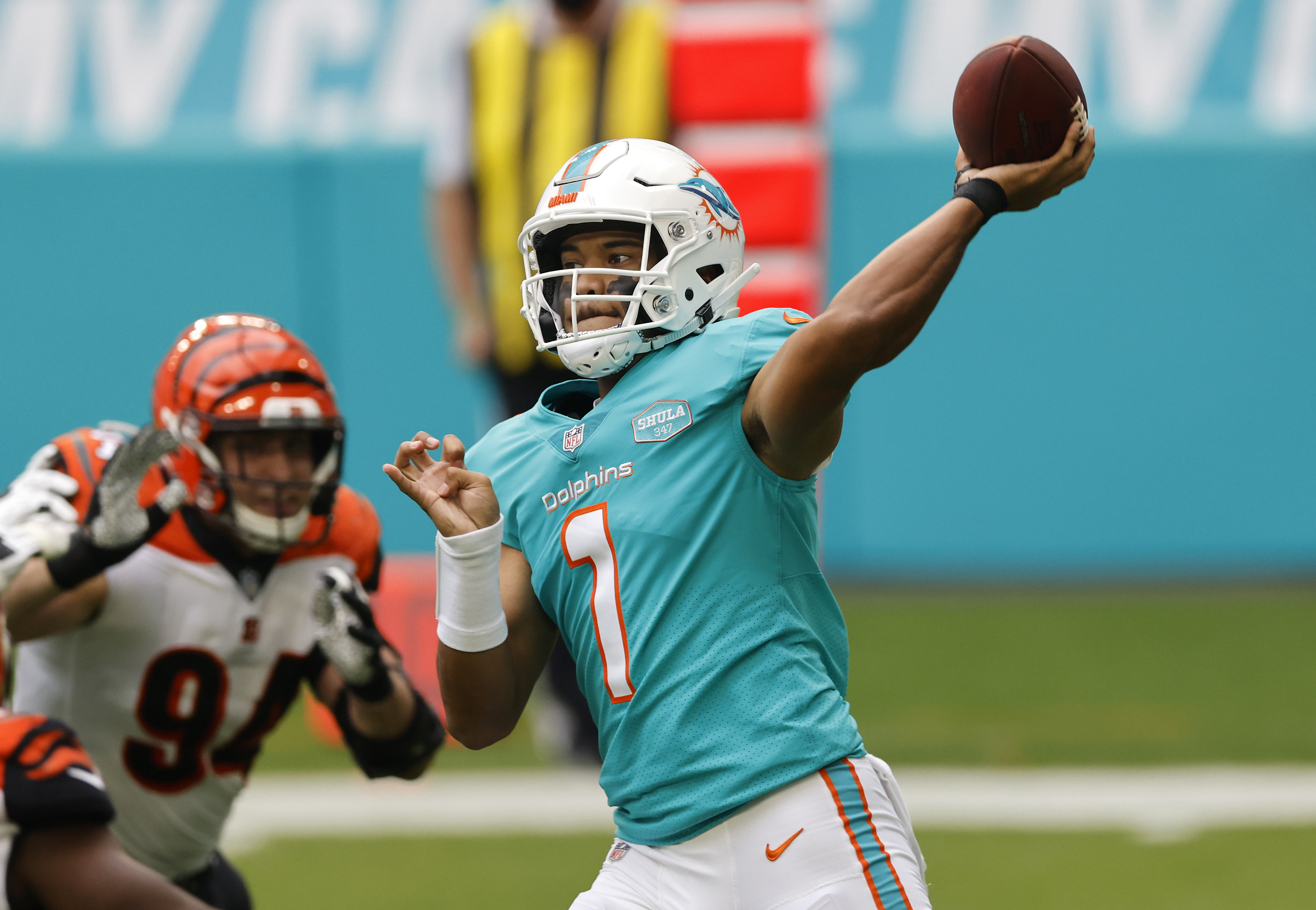 Dolphins white helmets and teal jersey
