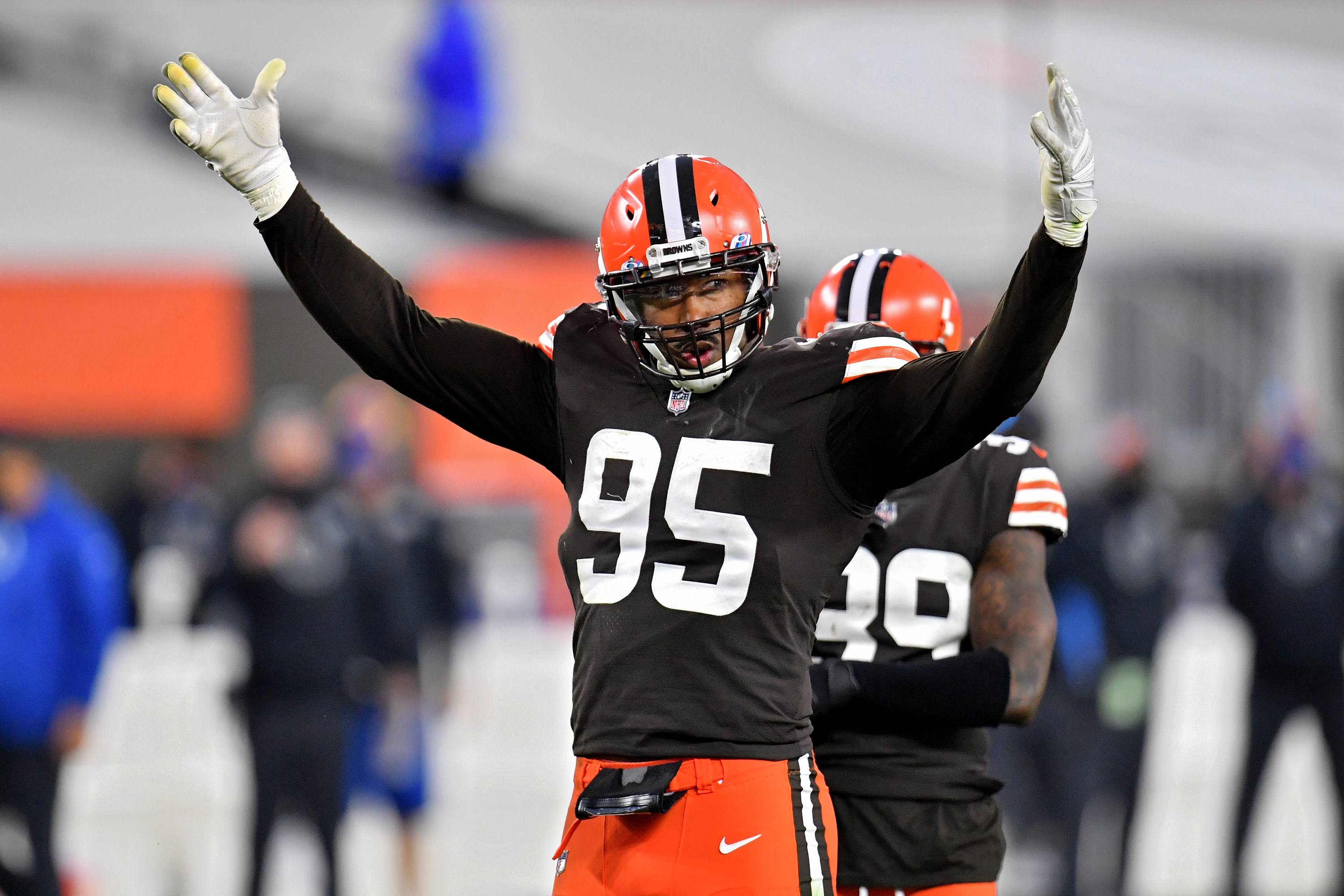 Browns uniforms brown jersey with orange helmet and white lettering