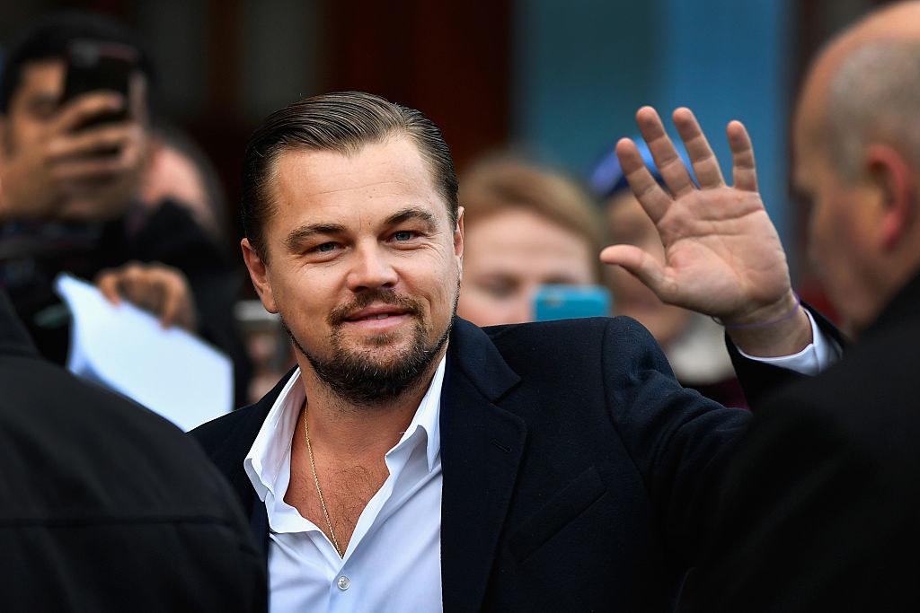 Leo DiCaprio waving at paparazzi