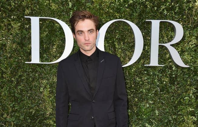 Robert Pattinson on the carpet for a Dior fashion show