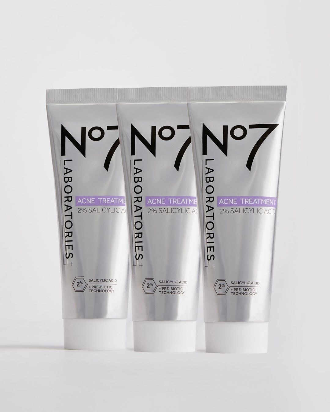 three tubes of No 7 acne treatment next to each other