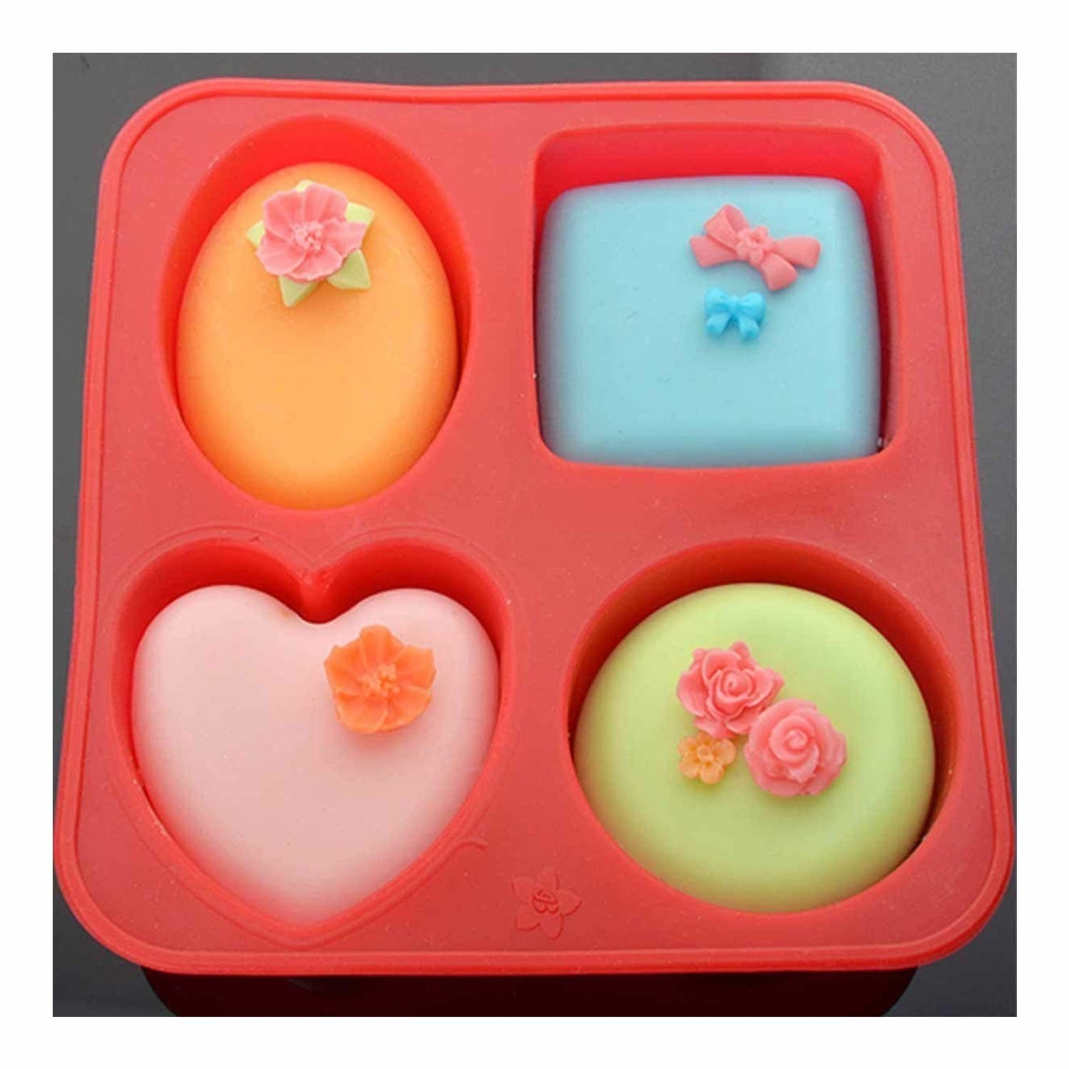 A mould with oval, square, round and heart-shaped slots