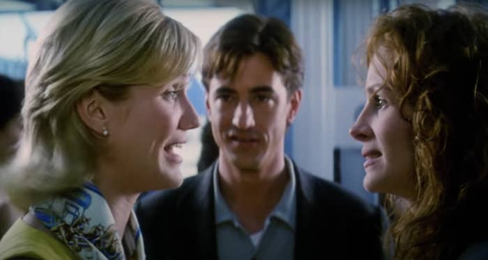 Kimmy, Jules, and Michael all talking at the airport