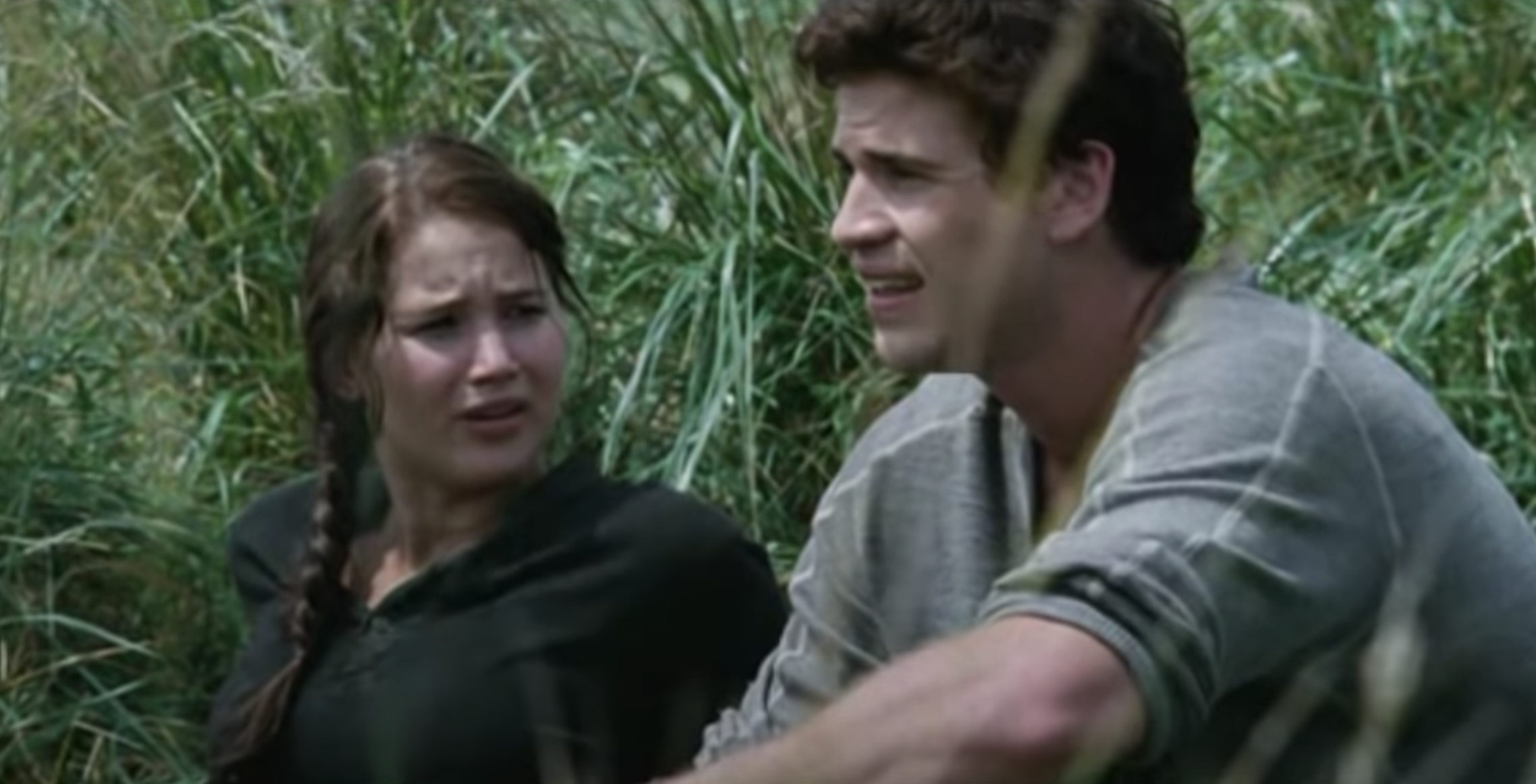 Katniss and Gale sitting in the meadow