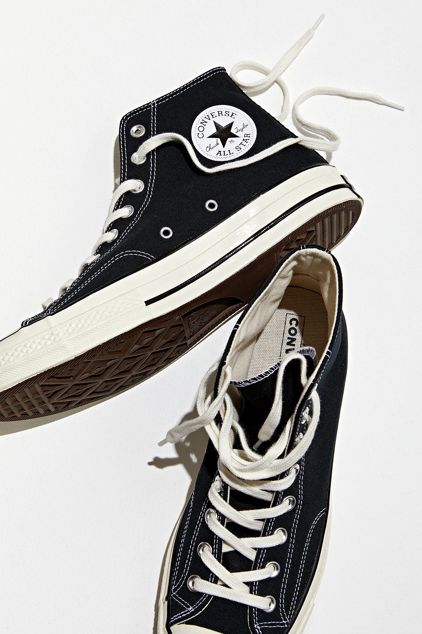 a pair of chuck converse shoes