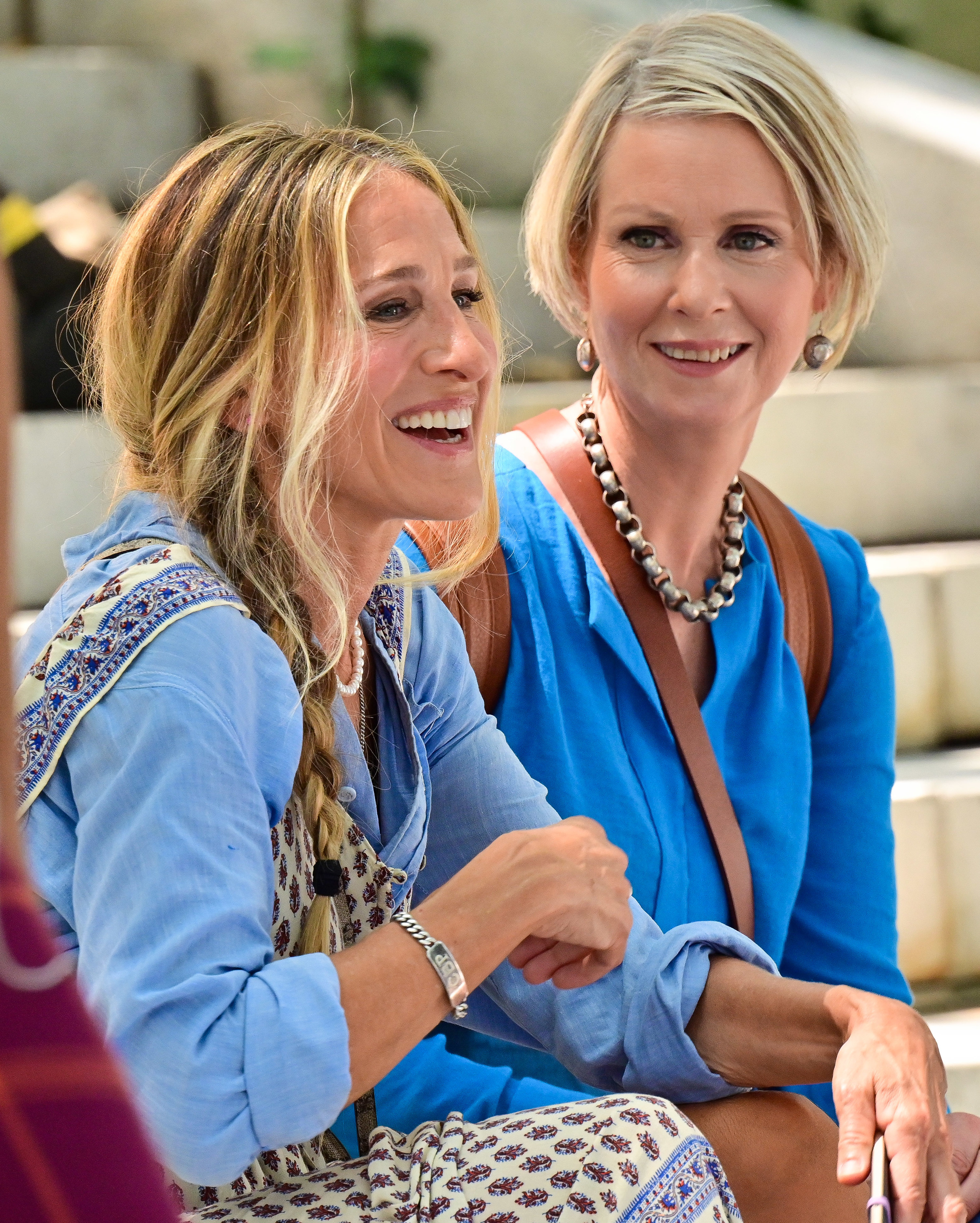 Sarah Jessica Parker and Cynthia Nixon are photographed sitting on the set of And Just Like That...