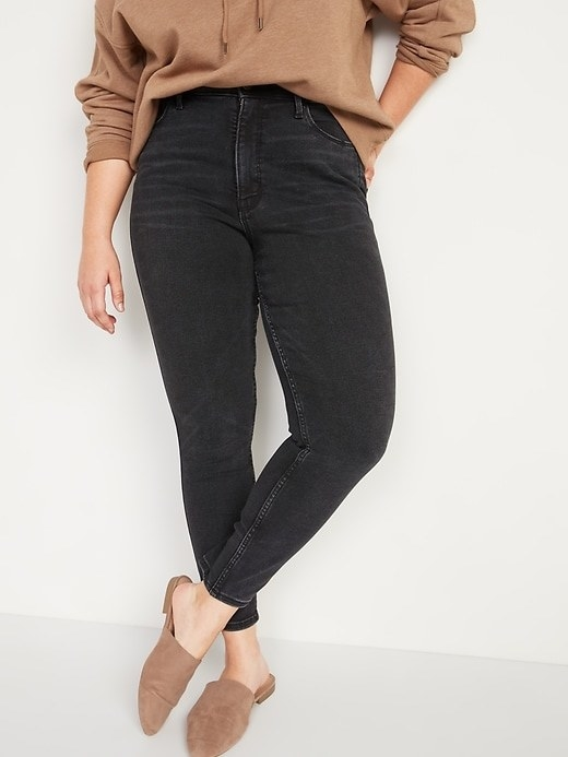 a person wearing a pair of skinny jeans with slides