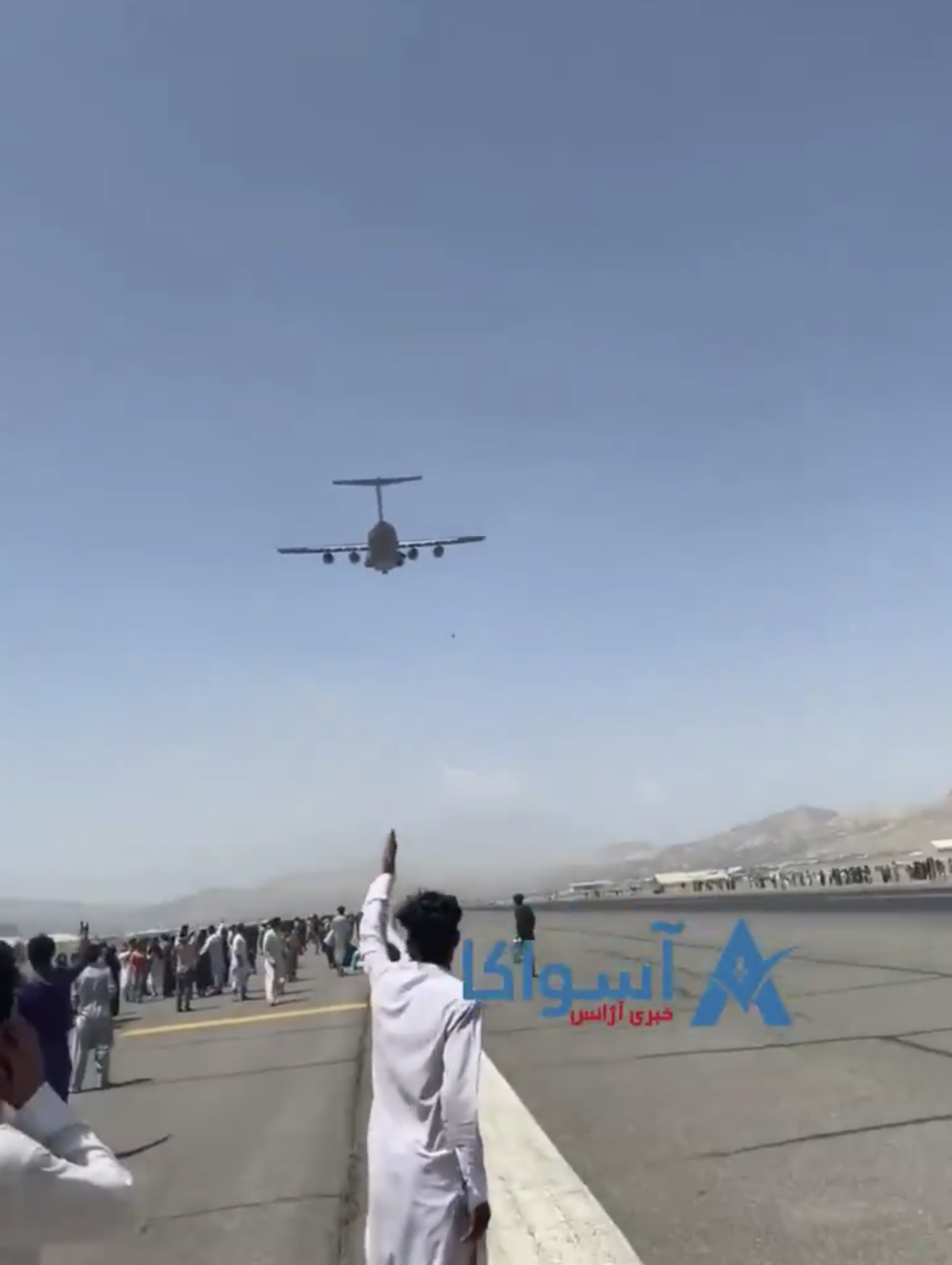 Person falls to their death from airborne C-17 plane, which they had clung to as it departed from the Kabul, Afghanistan, airport