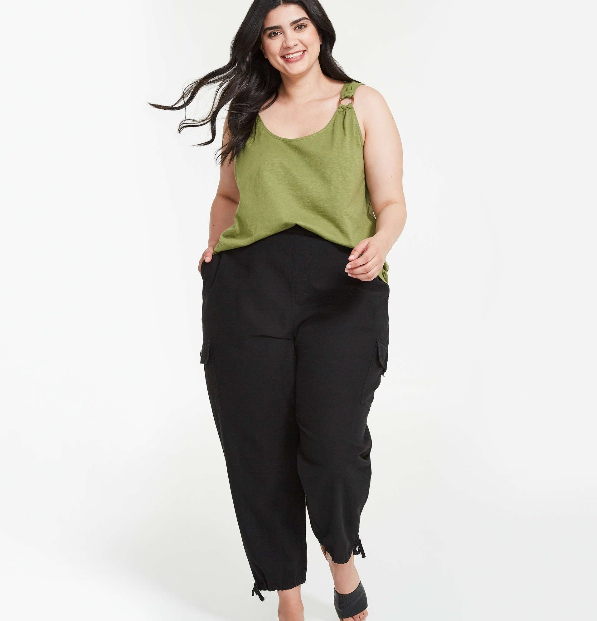 a person wearing the cargo pants with a tank