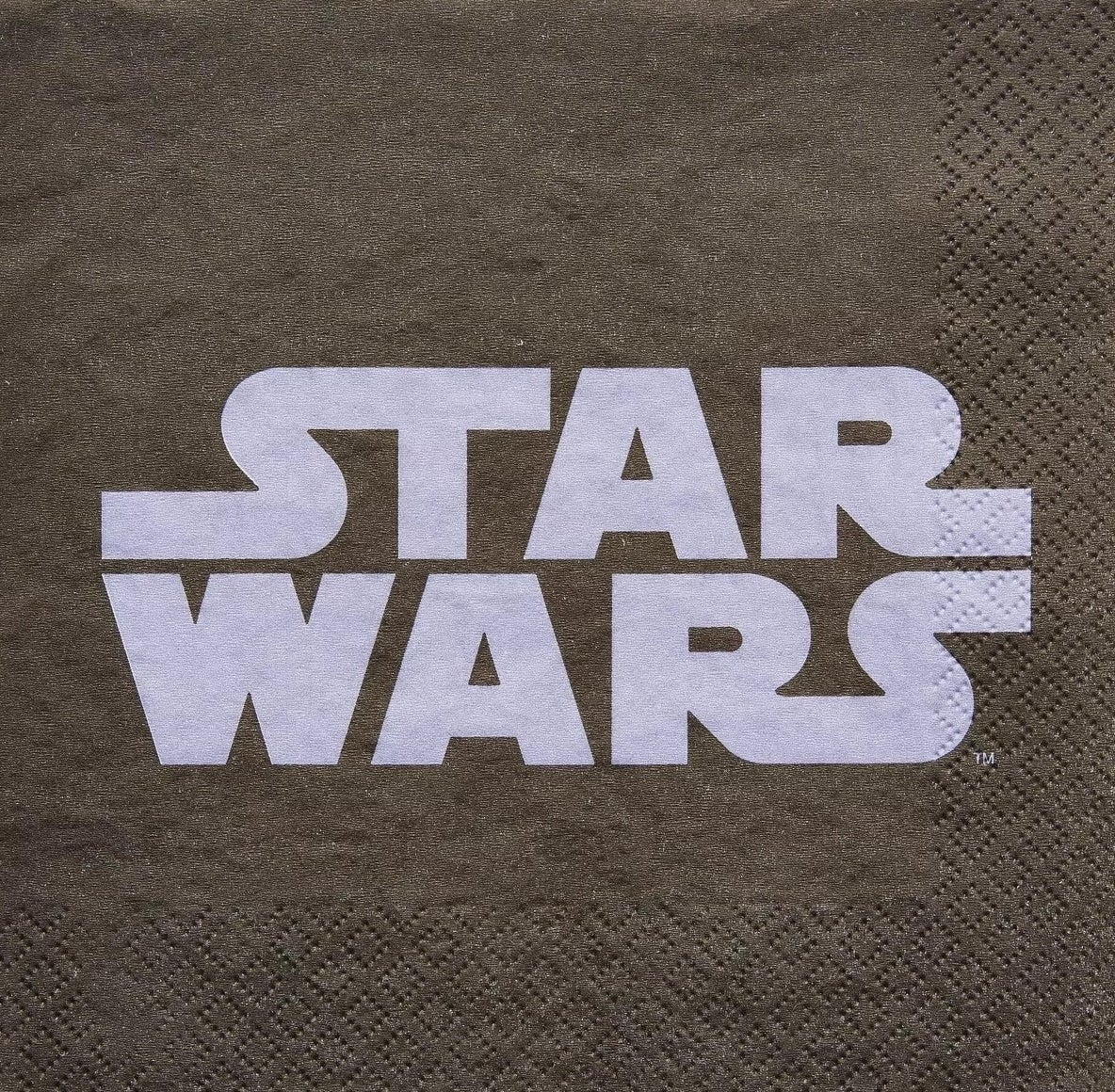 gray napkin with the logo for star wars in the center