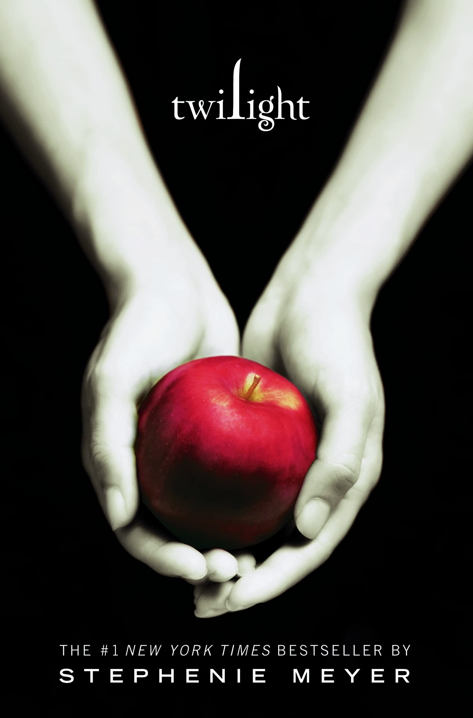 Book cover for Twilight; shows pale hands holding a red apple
