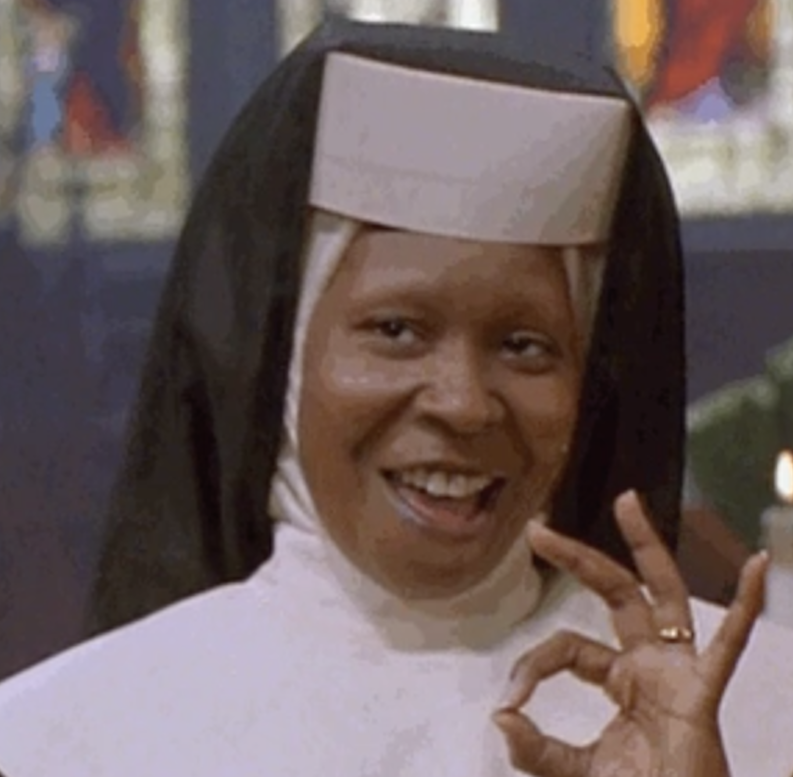 """Whoopi Goldberg in """"Sister Act"""" giving the """"okay"""" gesture with her hand"""