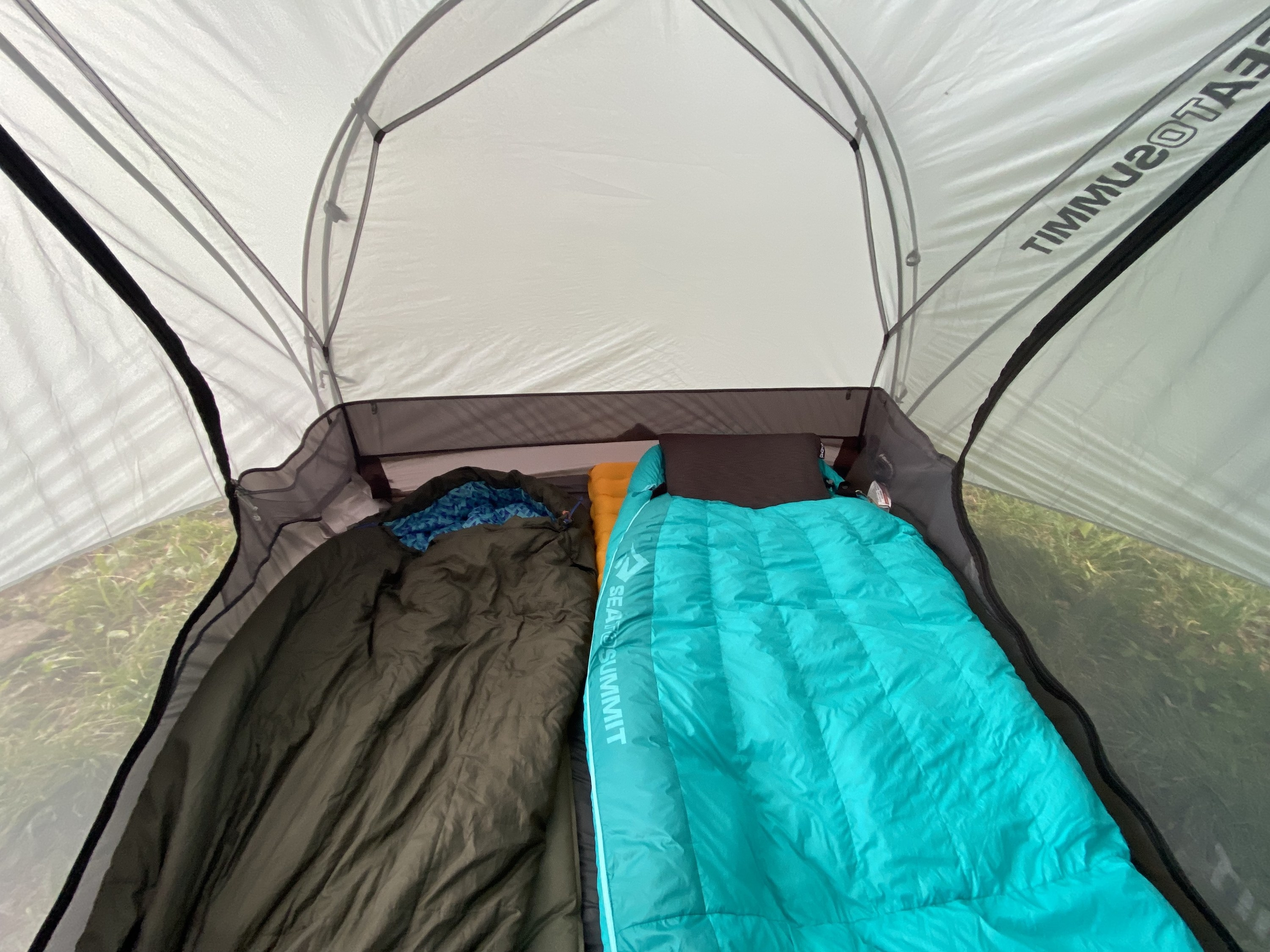 the inside of the tent with two sleeping bags