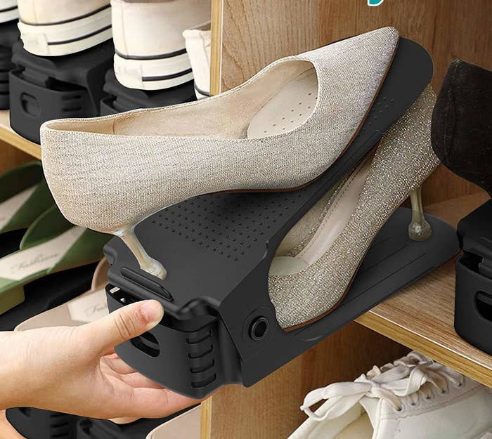 The organiser has an inclined plane to neatly place one shoe on top of the other, thereby halving the space required to store them