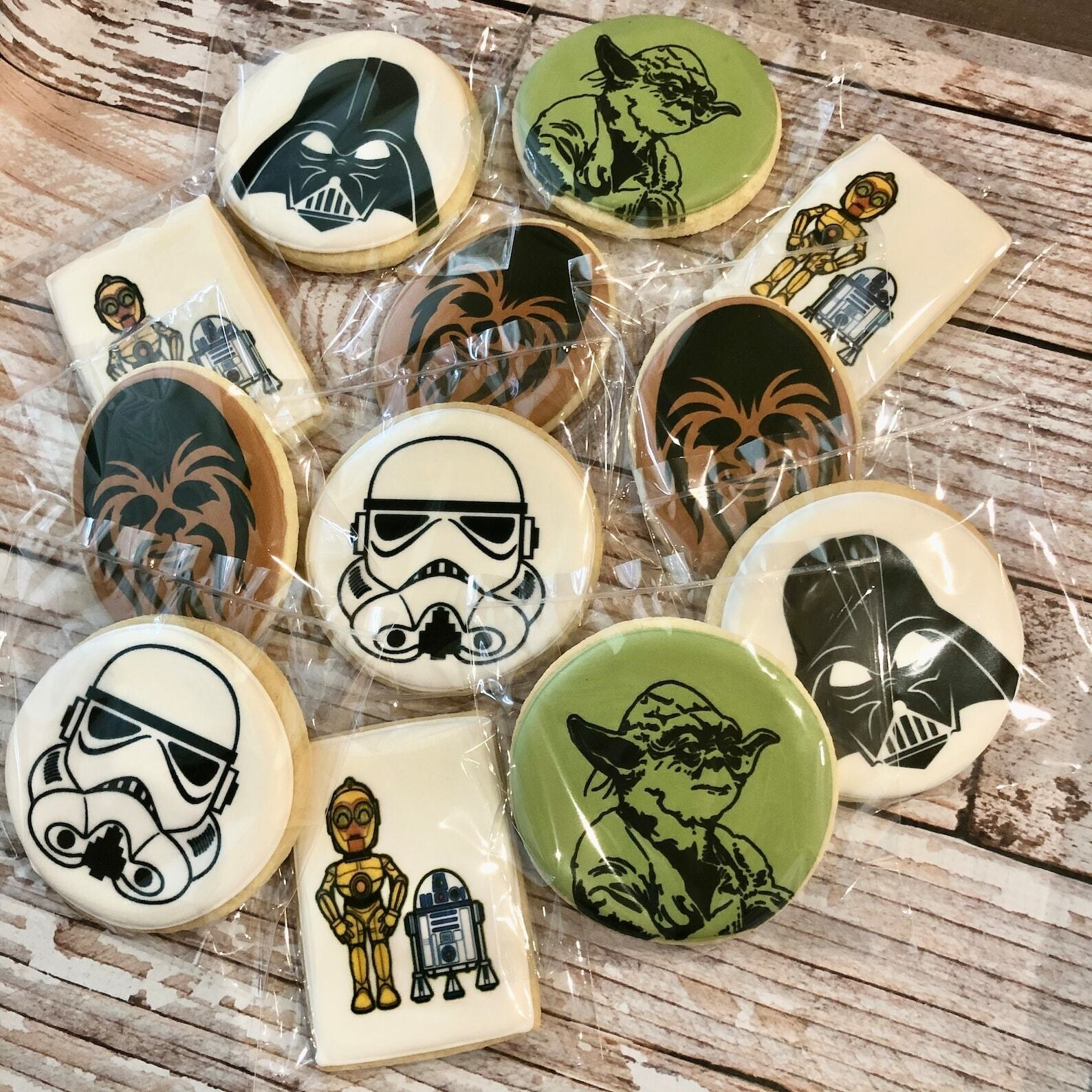 several cookies with printed star wars characters in the frosting on top