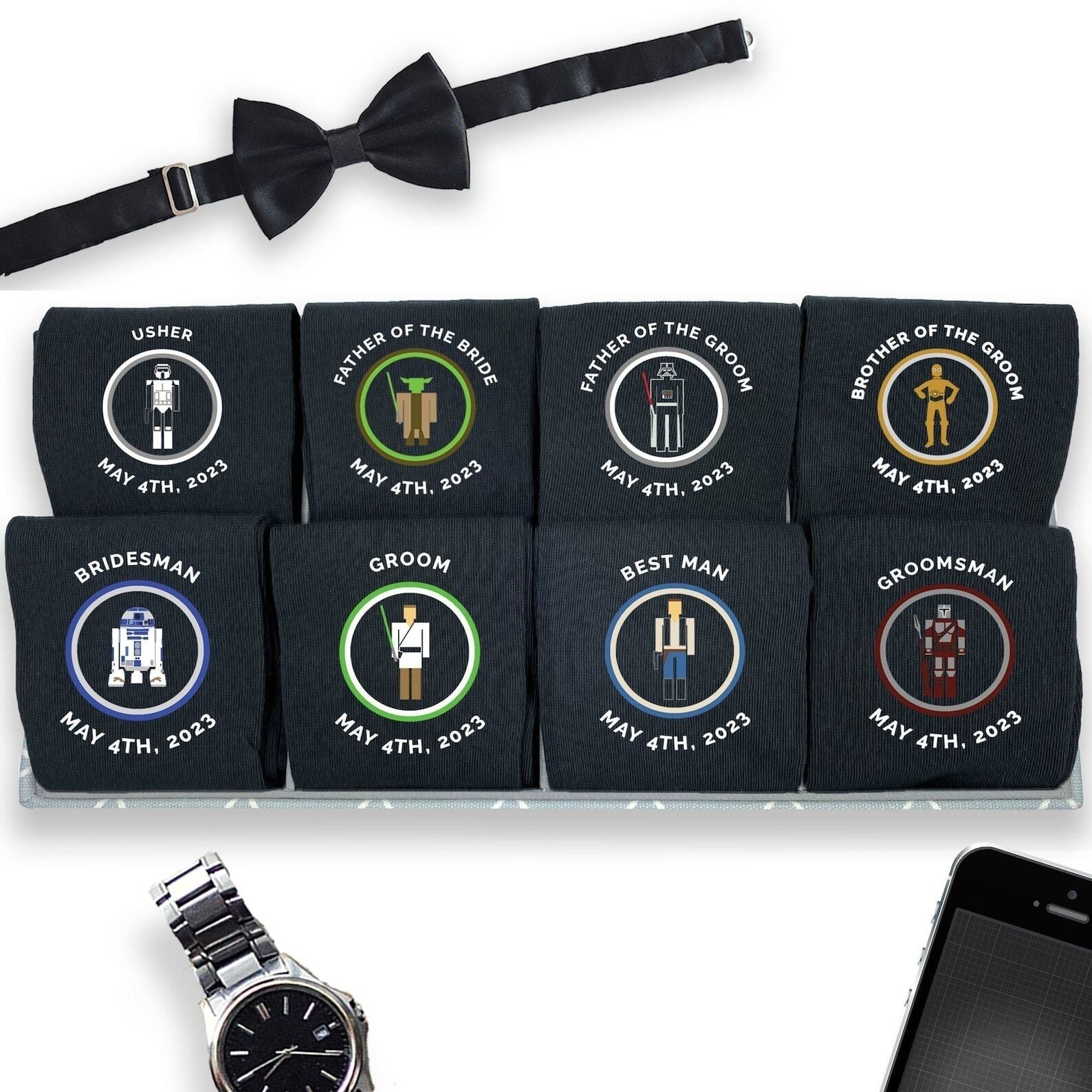several pairs of socks with different star wars character illustrations, a wedding date, and the role of the wedding participant printed on the sides