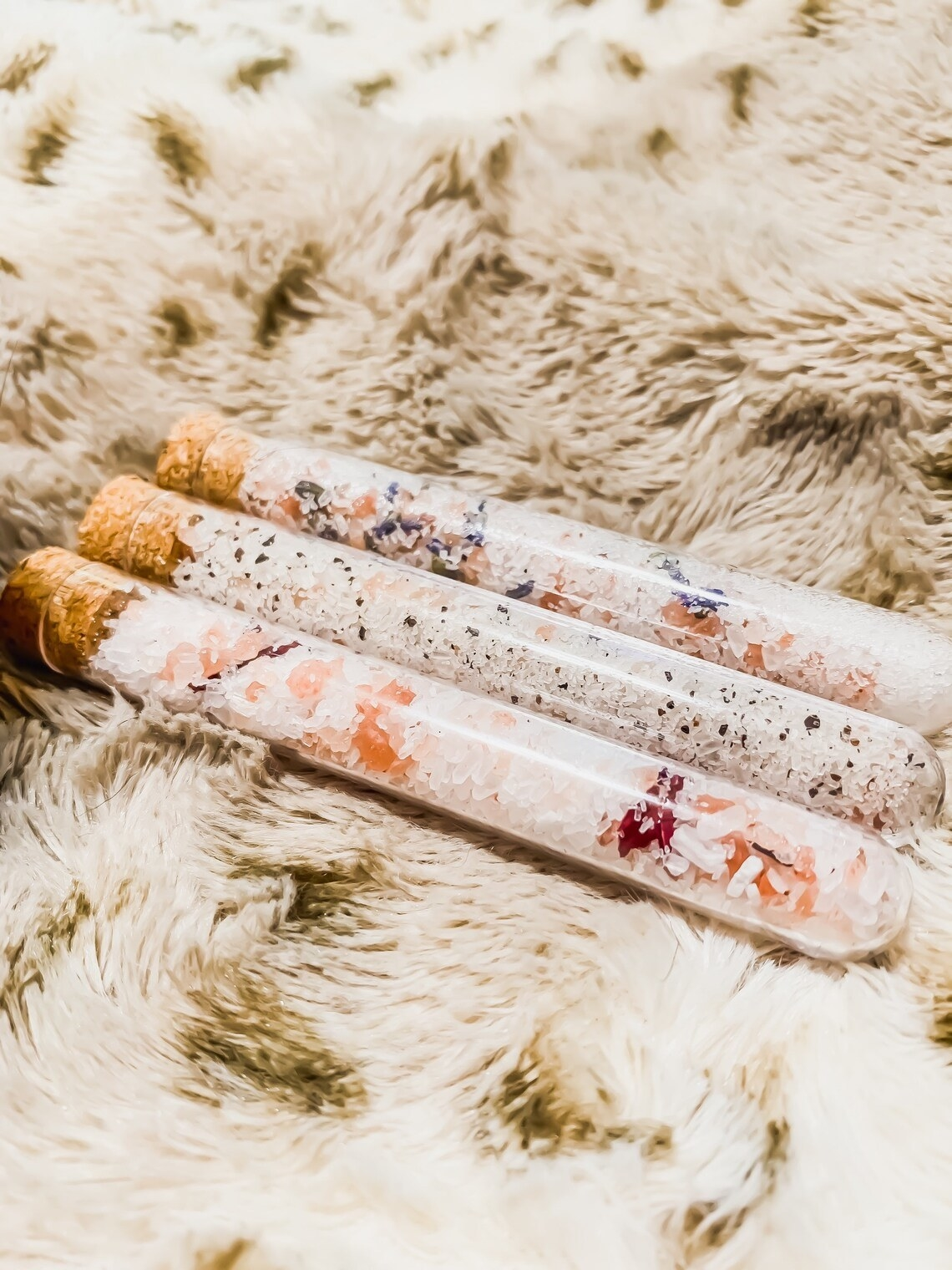 Three tubes of the bath salts laid out