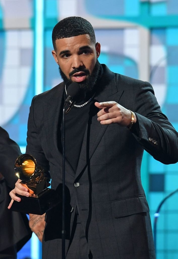 Drake onstage accepting a Grammy Award