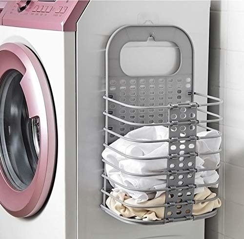 The metal laundry basket mounted on the side of a washing machine
