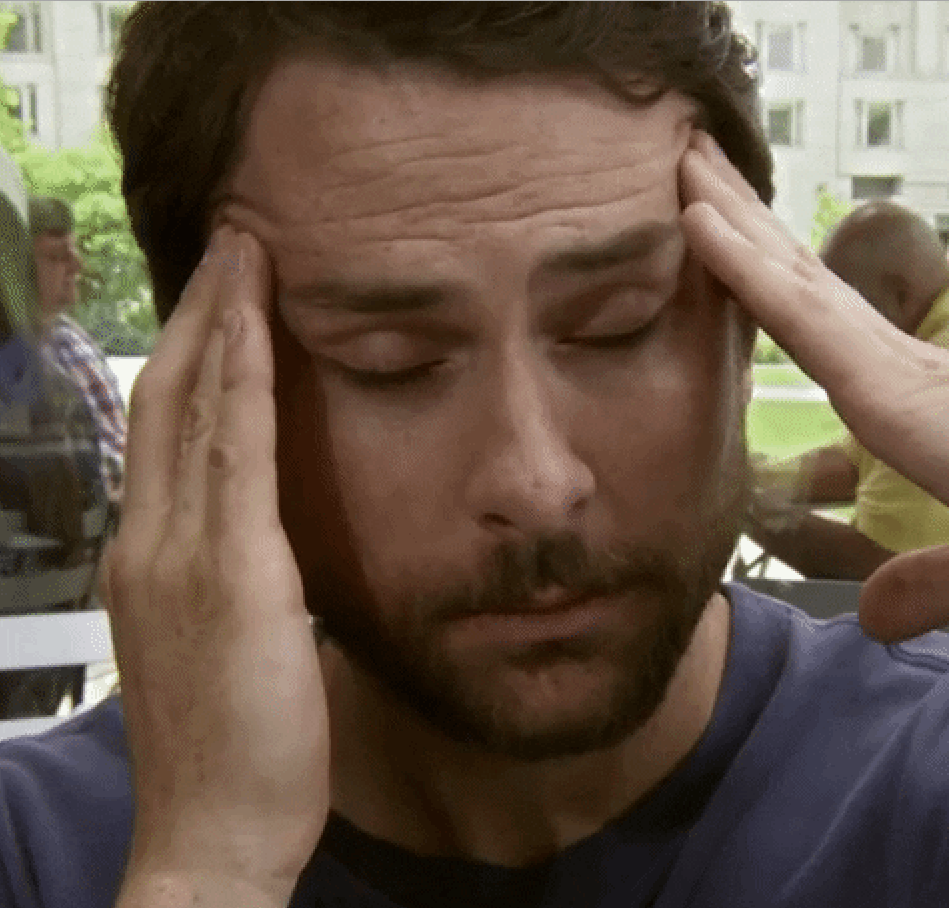 distraught Charlie Day rubbing his head in frustration