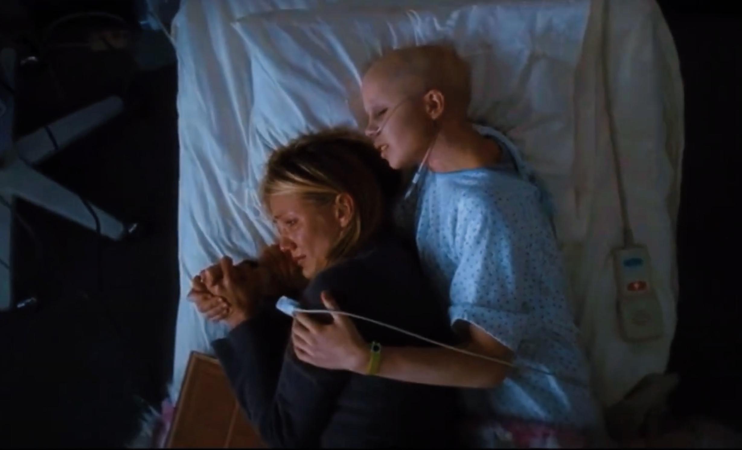 Kate hugging her mom in her hospital bed