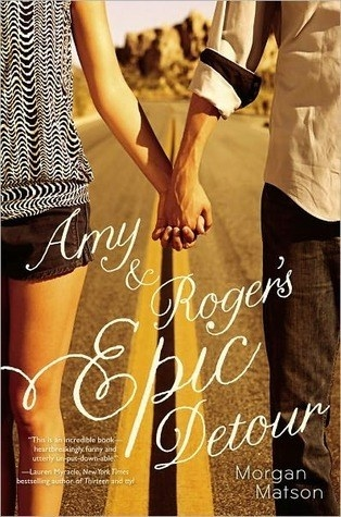 Book cover of two teens holding hands across a road with title text atop