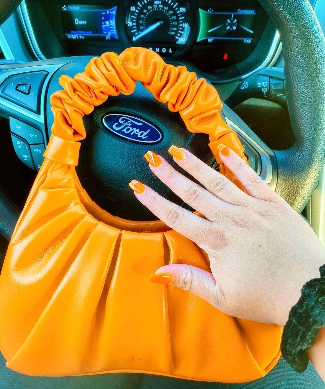 buzzfeed editor's bag in orange
