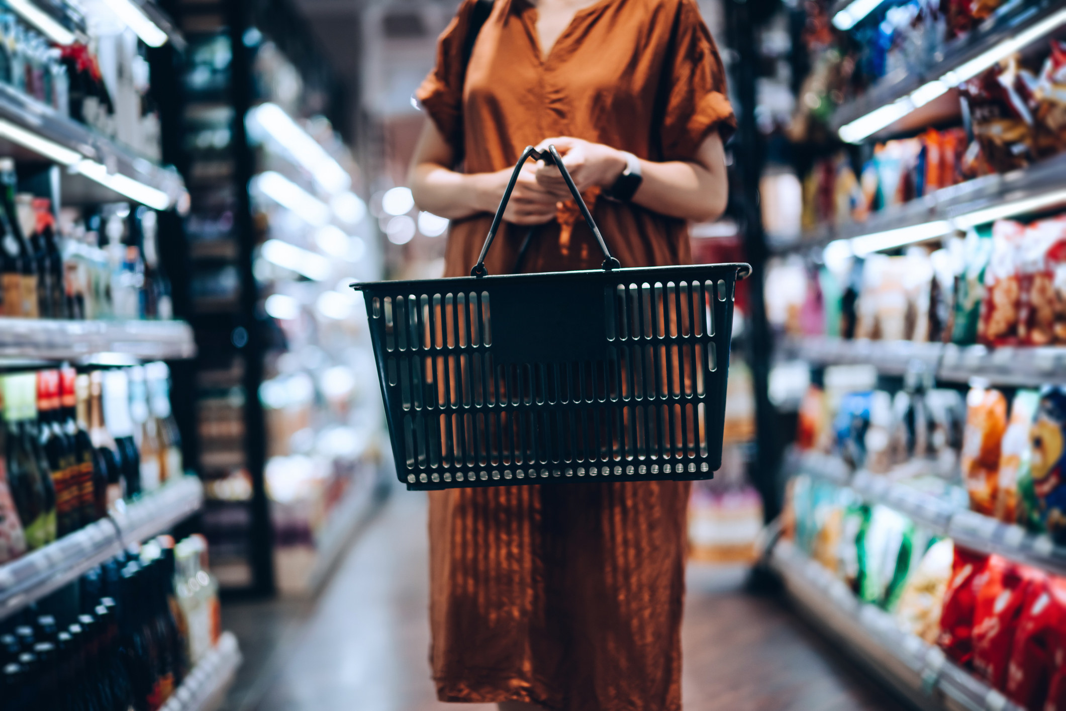 A woman shopping at a grocery store.