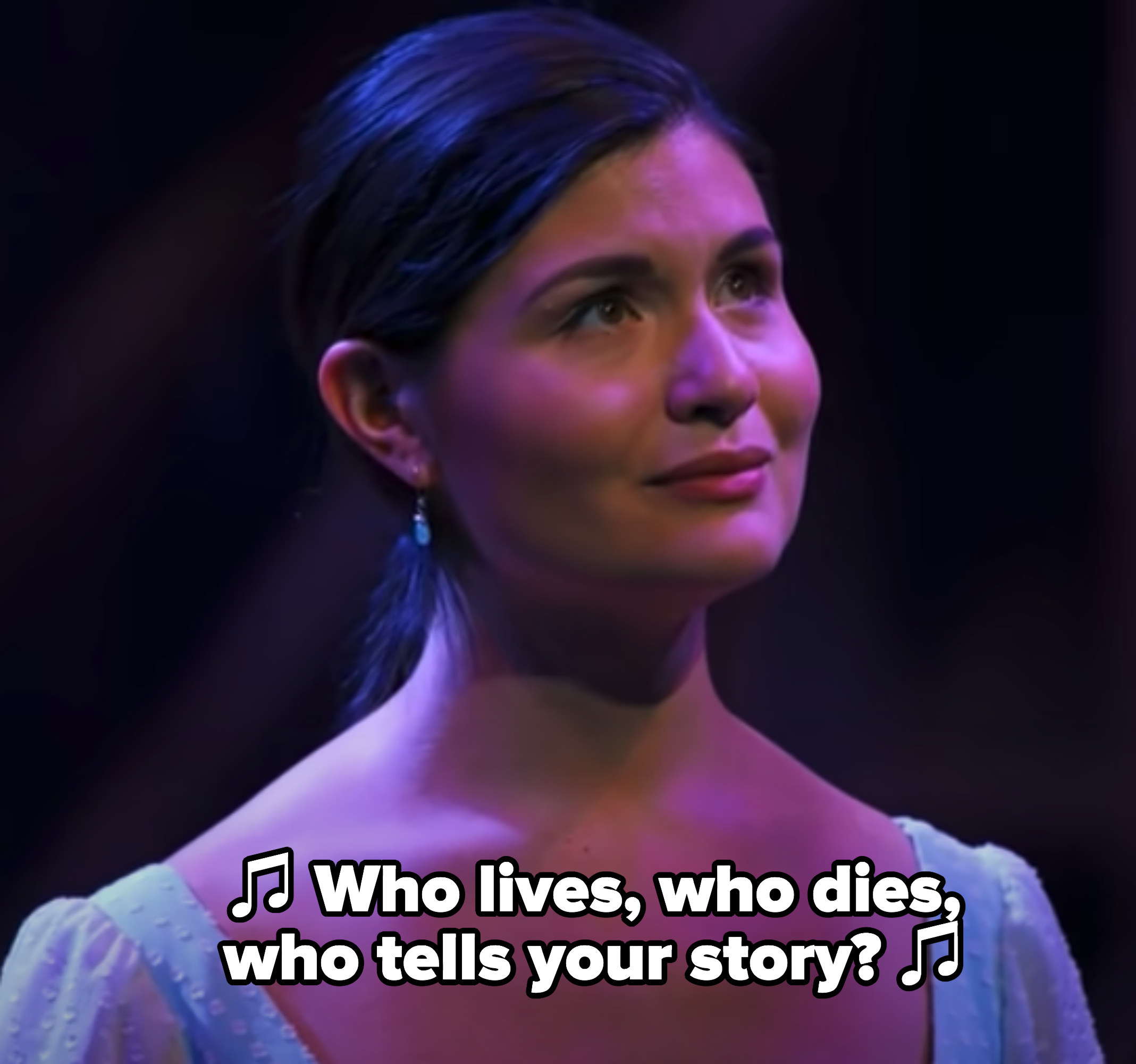 """Phillipa Soo in """"Hamilton"""" with actors singing """"Who lives, who dies, who tells your story?"""" in the background"""