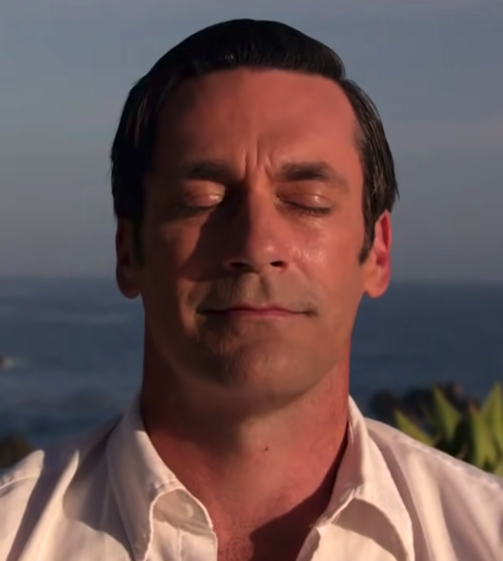 """Jon Hamm in the finale scene of """"Mad Men,"""" meditating on a hill"""