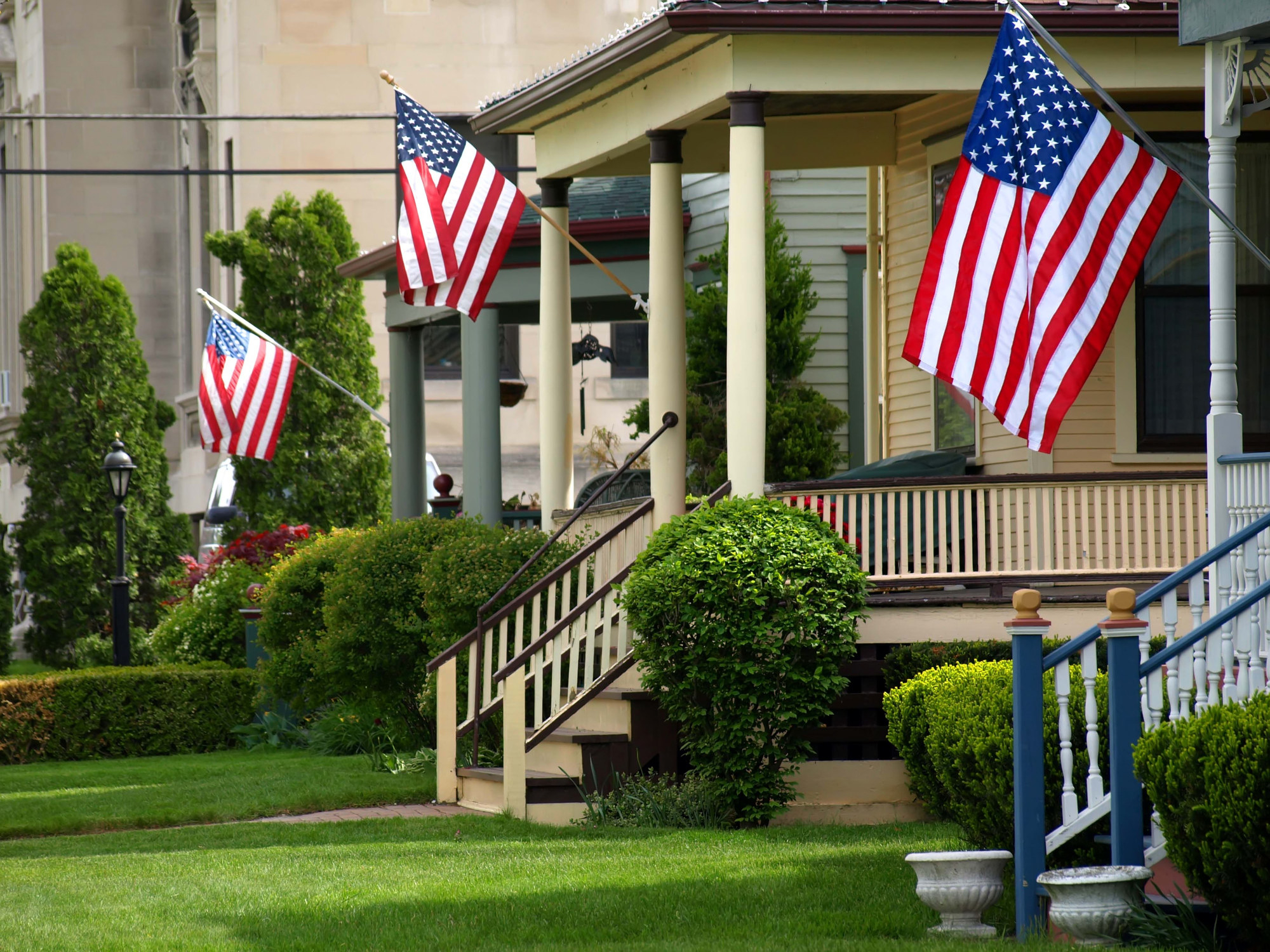 American flags flying on porches.