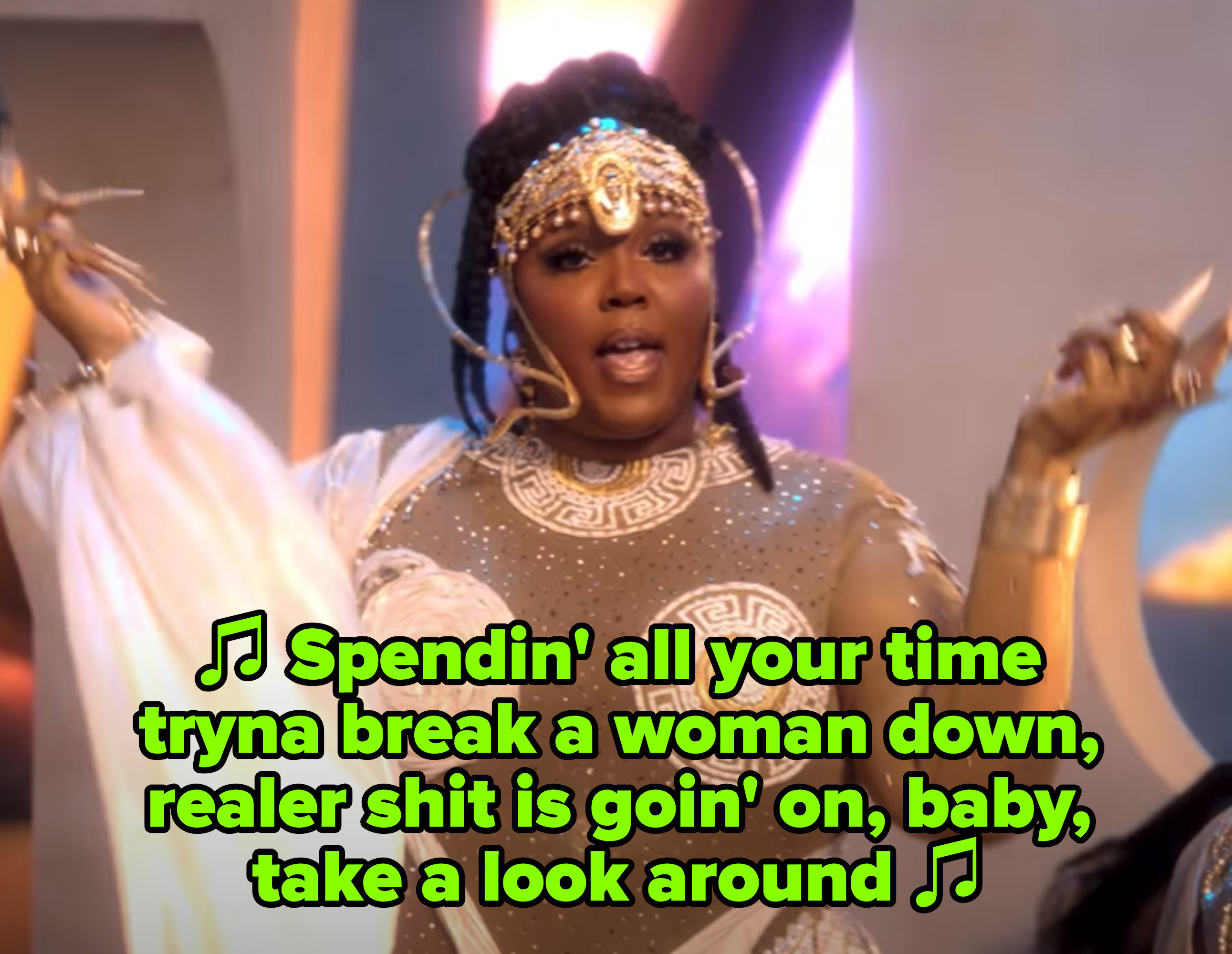 """Lizzo in her """"Rumors"""" music video singing: """"Spendin' all your time tryna break a woman down, realer shit is goin' on, baby, take a look around"""""""