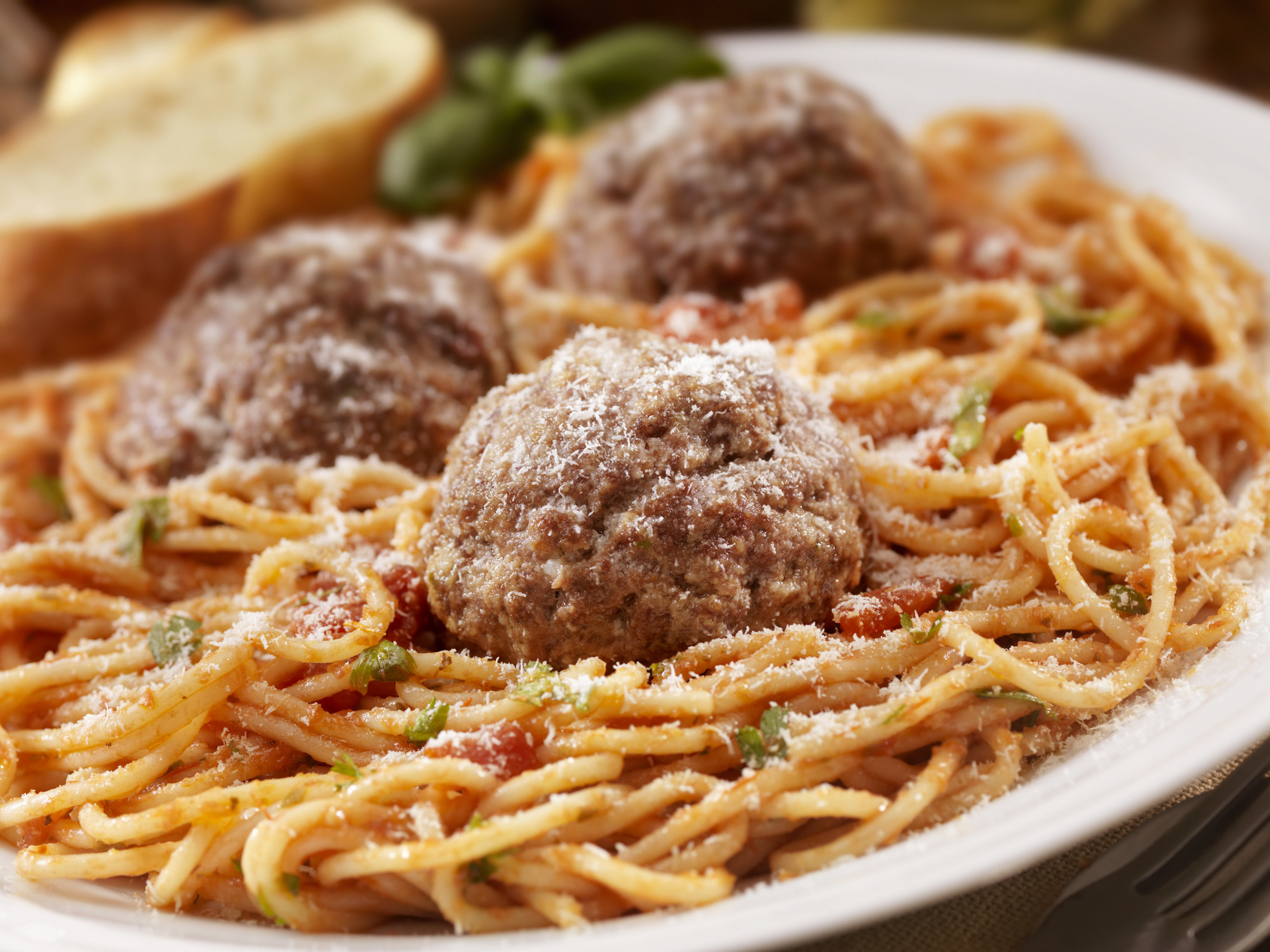 A big plate of spaghetti and meatballs.