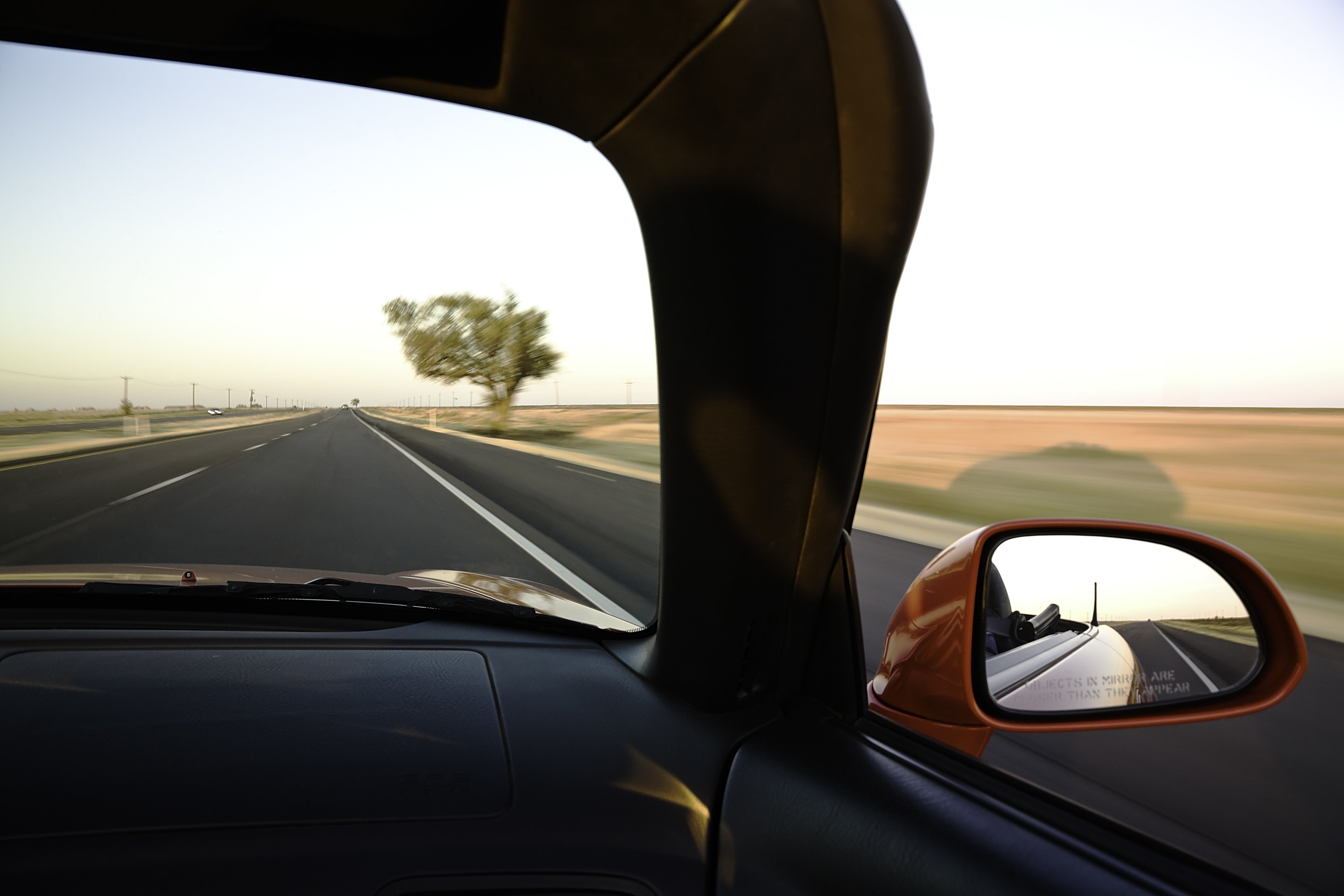 Driving on an open road.