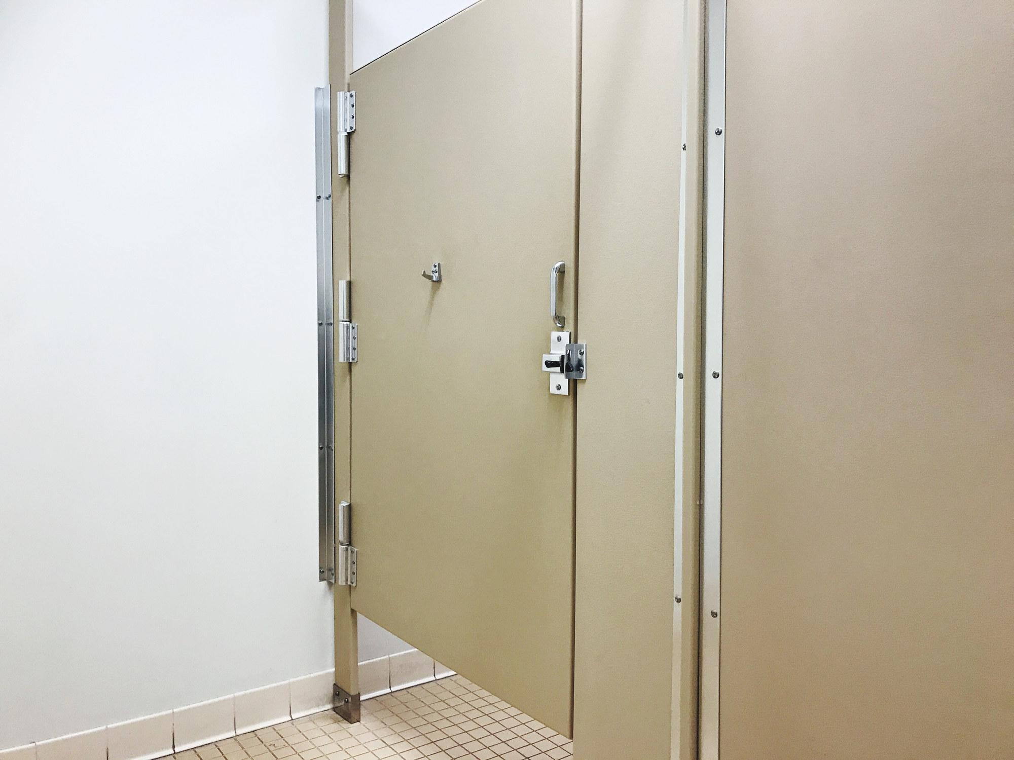 Public bathroom stalls with large gaps.