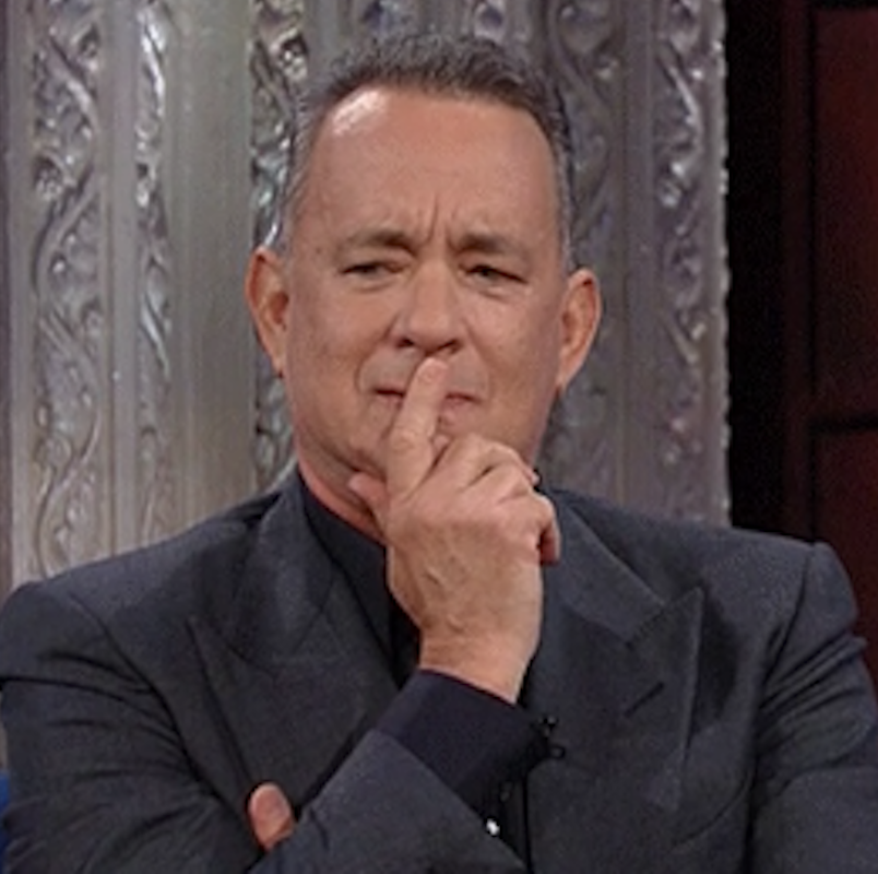 """Tom Hanks on """"The Late Show with Stephen Colbert"""" in a thinking pose"""