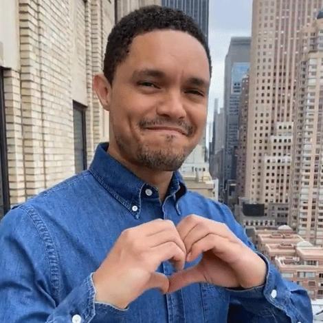 "Trevor Noah giving a heart symbol on ""The Daily Show with Trevor Noah"""