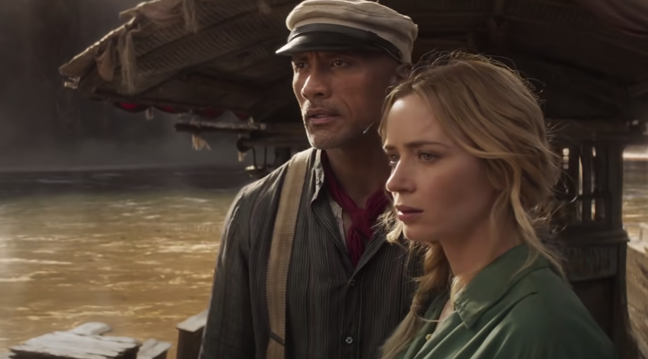 Lily and Frank looking ahead while standing next to each other on the boat