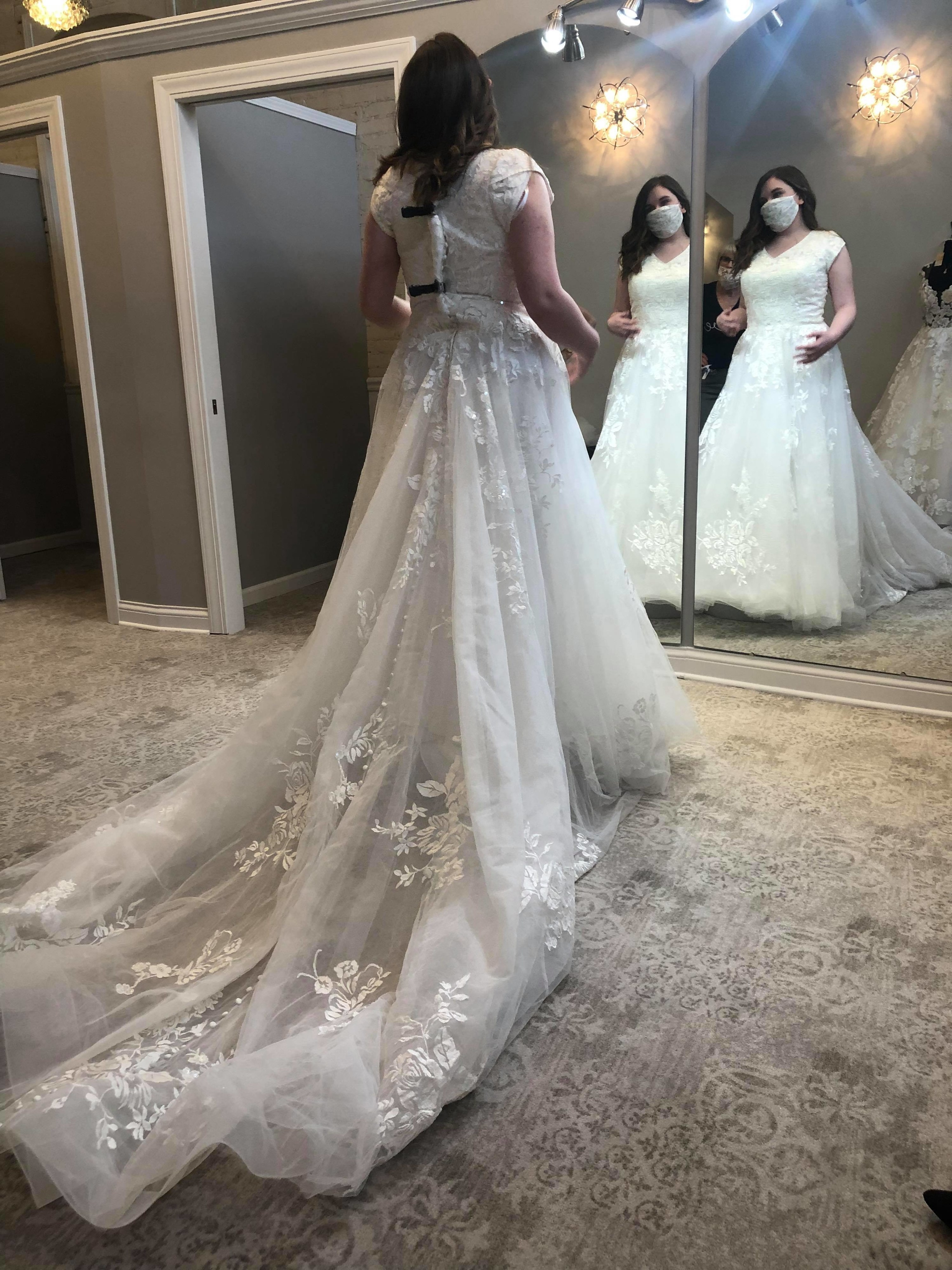 An image of the author trying on a wedding dress
