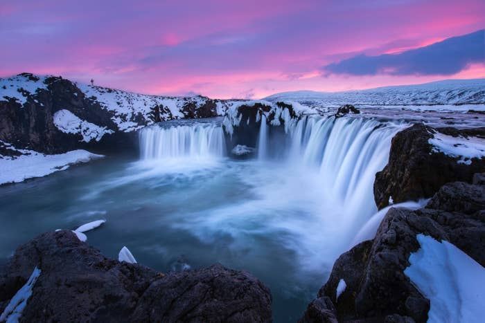A waterfall in Iceland during sunset