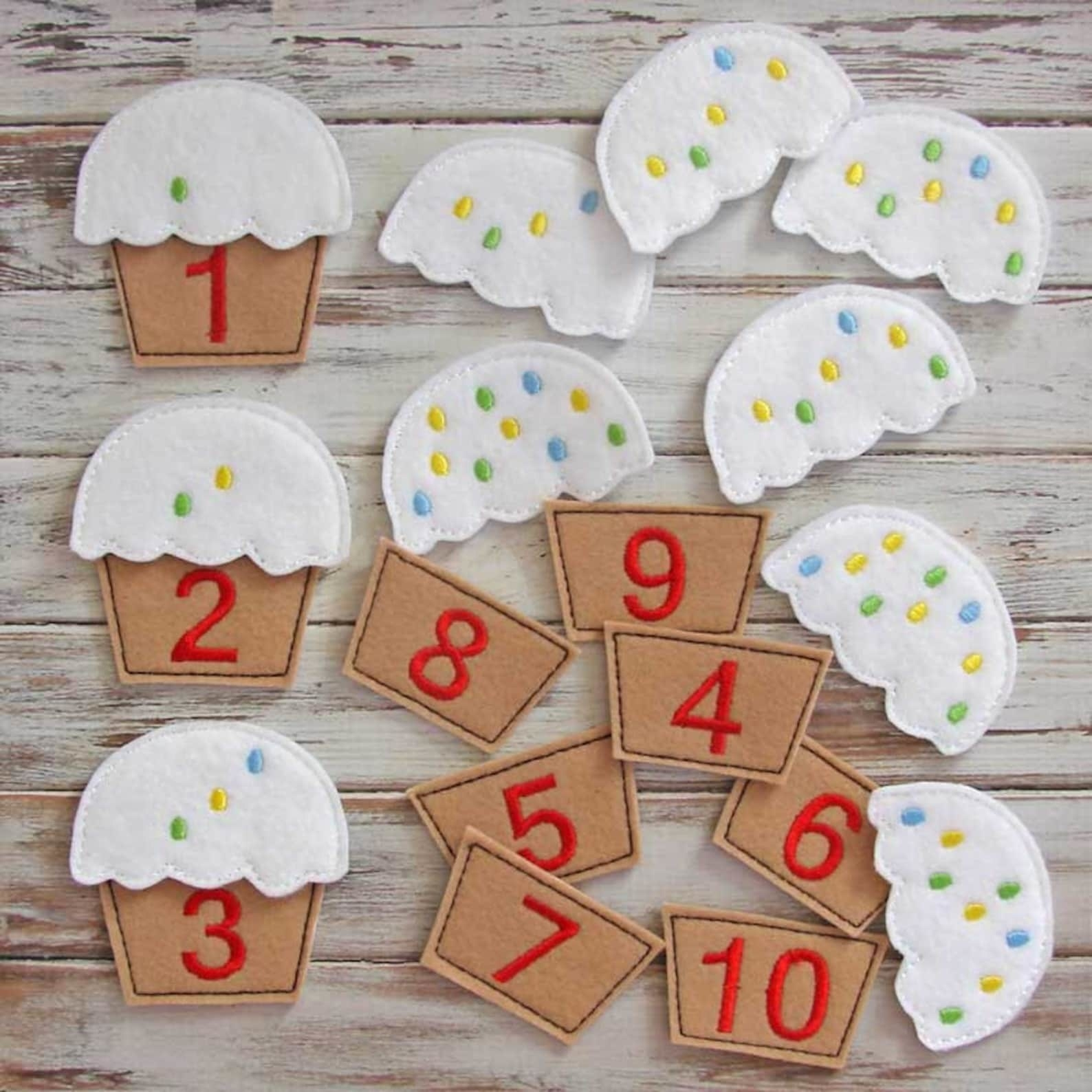 The white and brown felt cupcakes with embroidered numbers