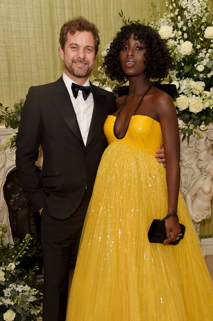 Joshua Jackson has his arm around Jodie Turner Smith as they pose for a photo on the red carpet