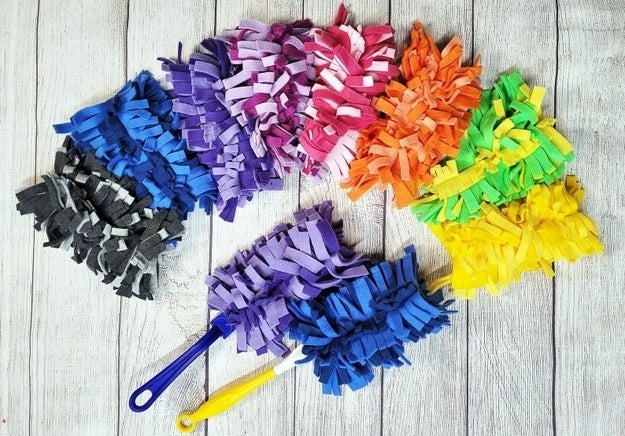 Cut up fleece fabric swiffer heads in different color combinations