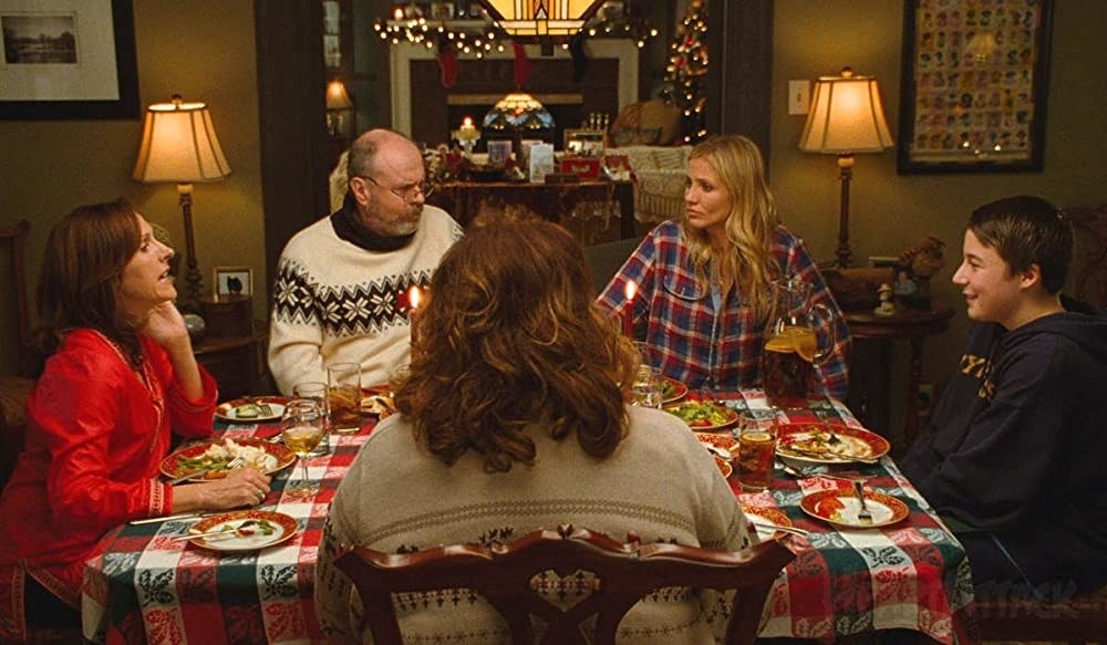 Molly Shannon sits at a dinner table with her family